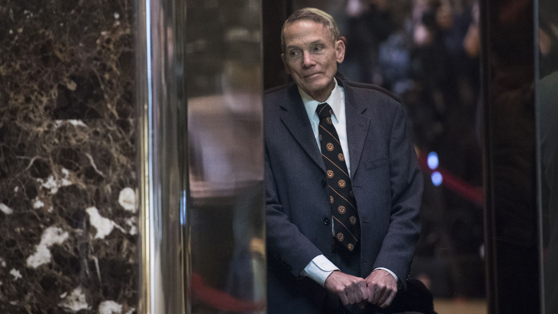 Physicist William Happer arrives in the lobby of Trump Tower in New York, N.Y.