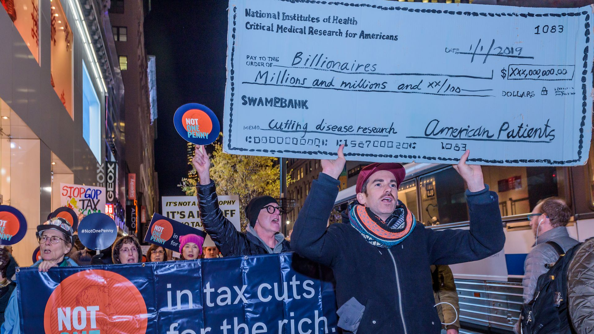 Anti-tax cut protestors march in Manhattan