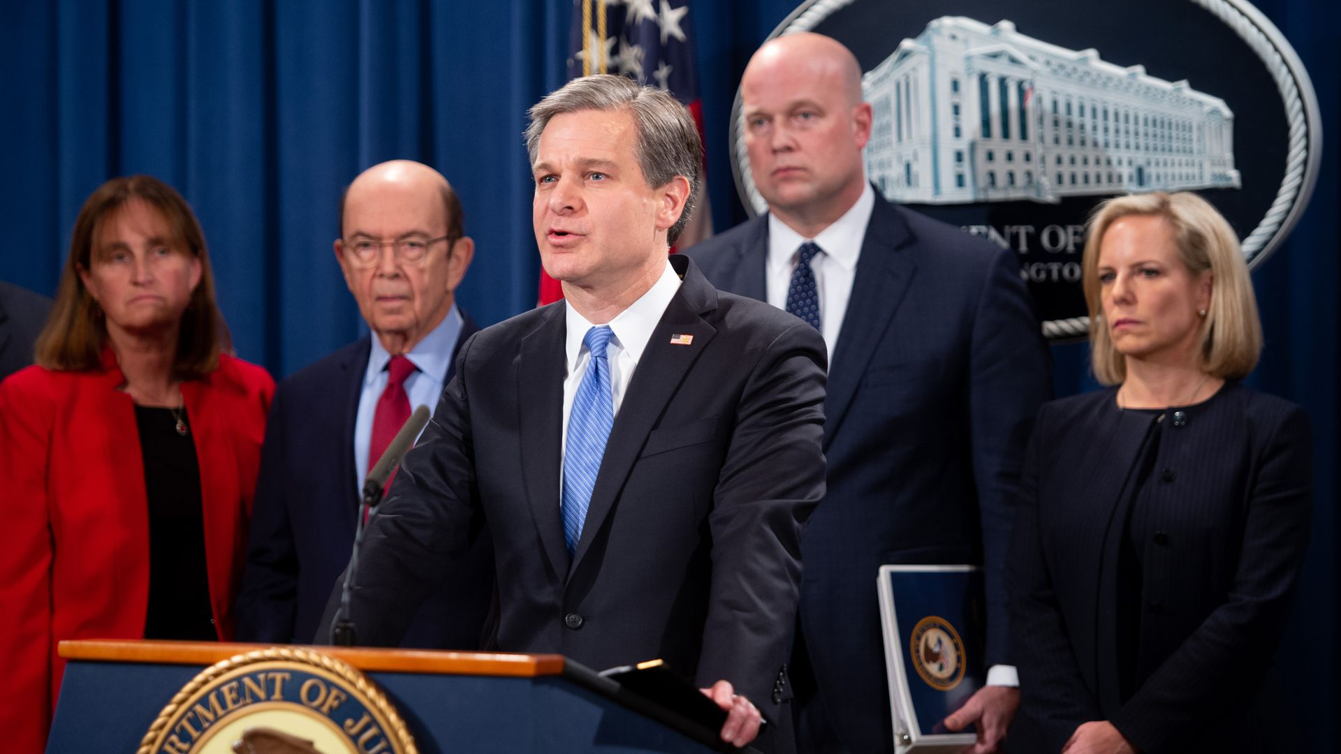 FBI Director Christopher Wray announces a 13-count indictment of financial fraud charges against Chinese telecommunications manufacturer Huawei