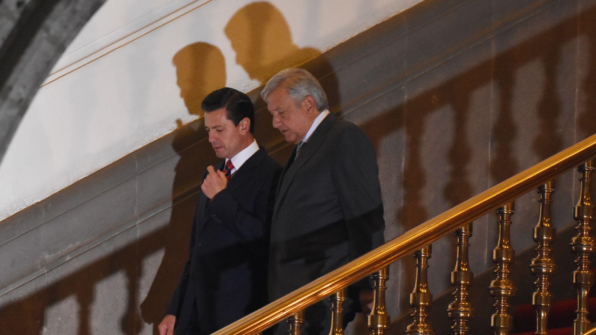 Mexican President Enrique Peña Nieto walks down stairs