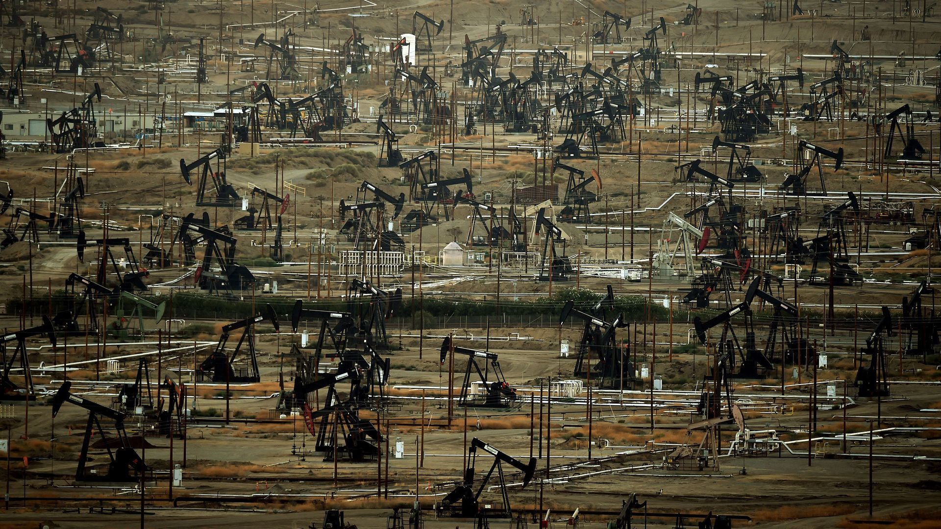 A general view shows oil pumping jacks and drilling pads at the Kern River Oil Field