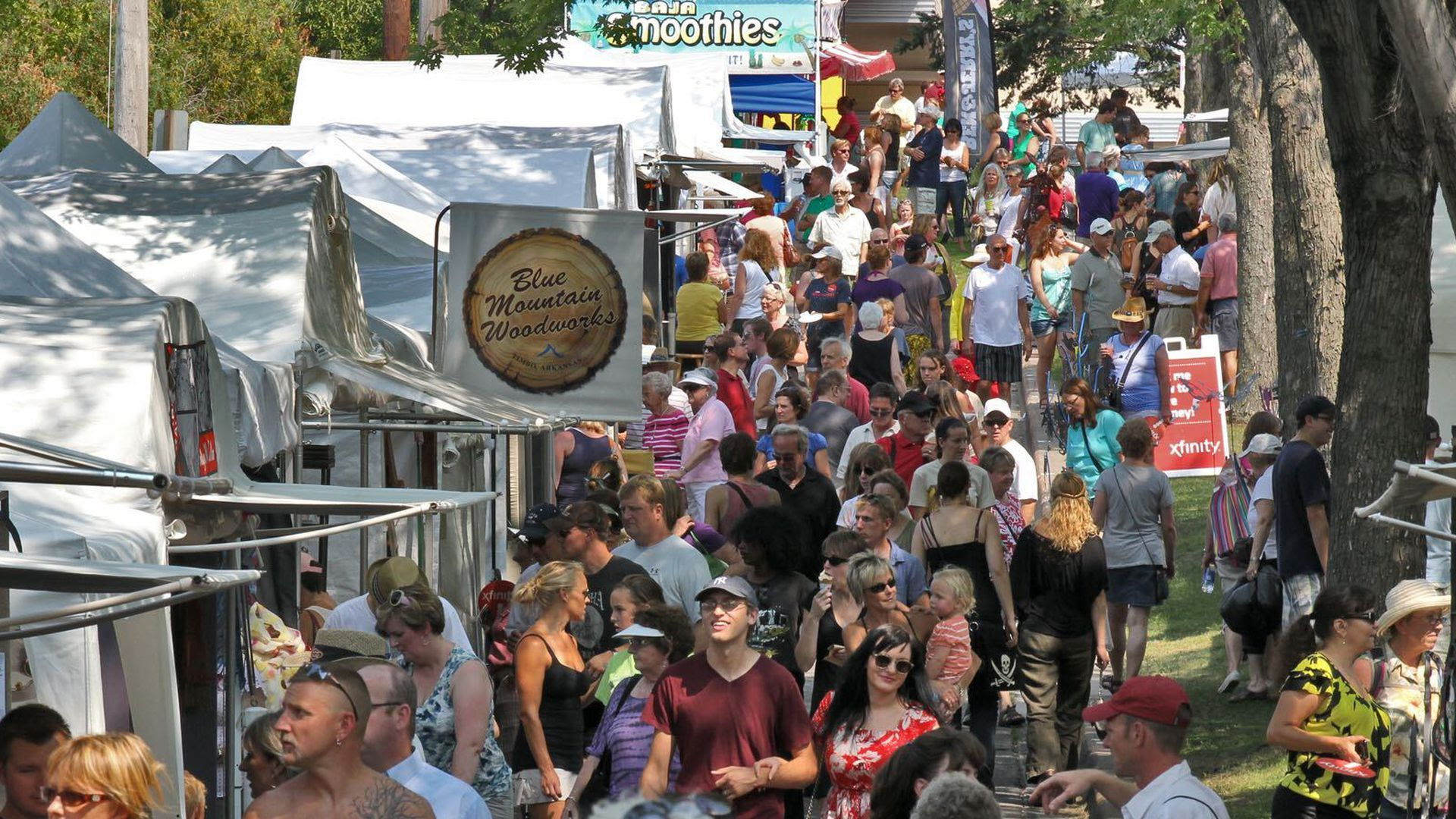 Large crowds gather by tents at Minneapolis' Uptown Art Fair