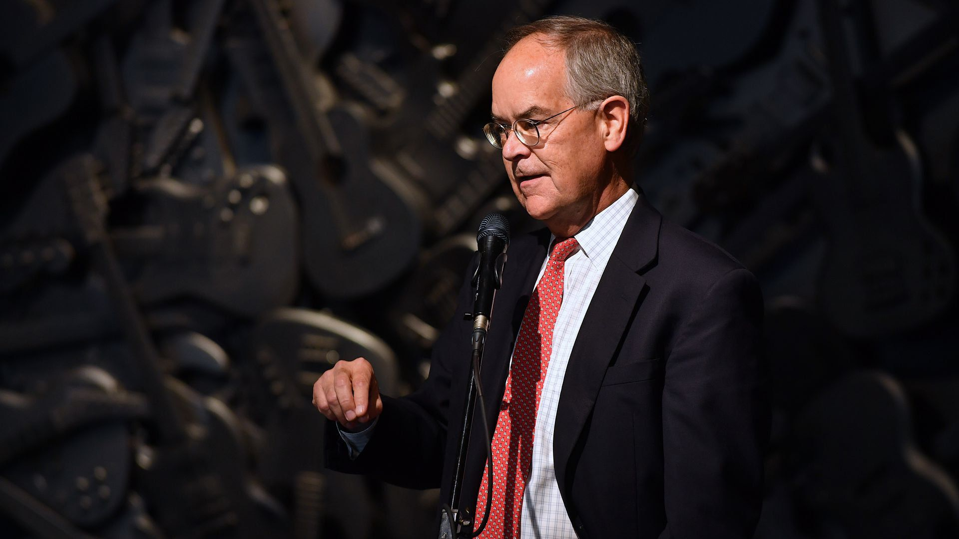 U.S. Rep. Jim Cooper speaks on stage in front of a microphone.
