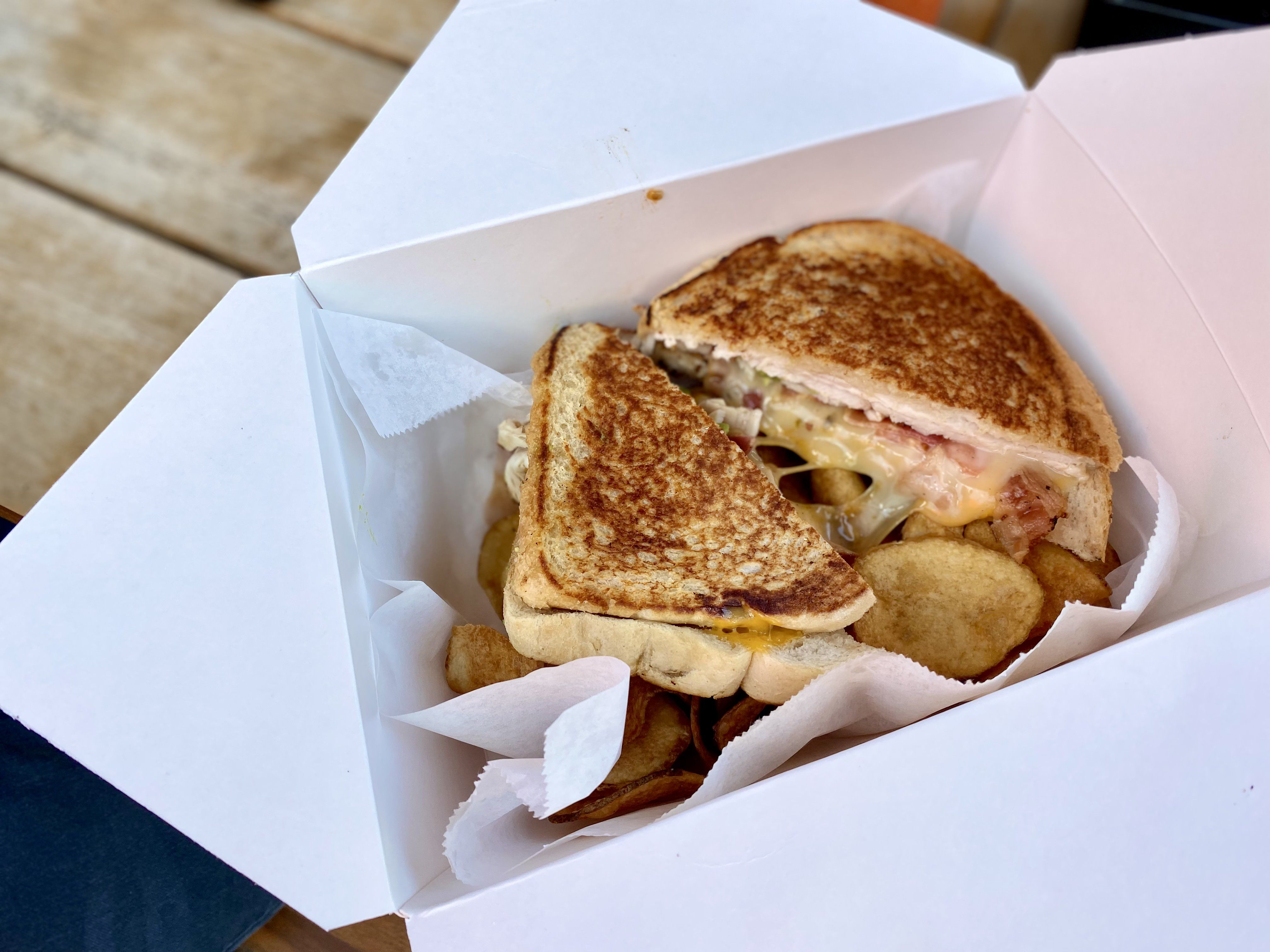 A sandwich and fries from Wich, Please.  Photo credit: Ben Montgomery / Axios