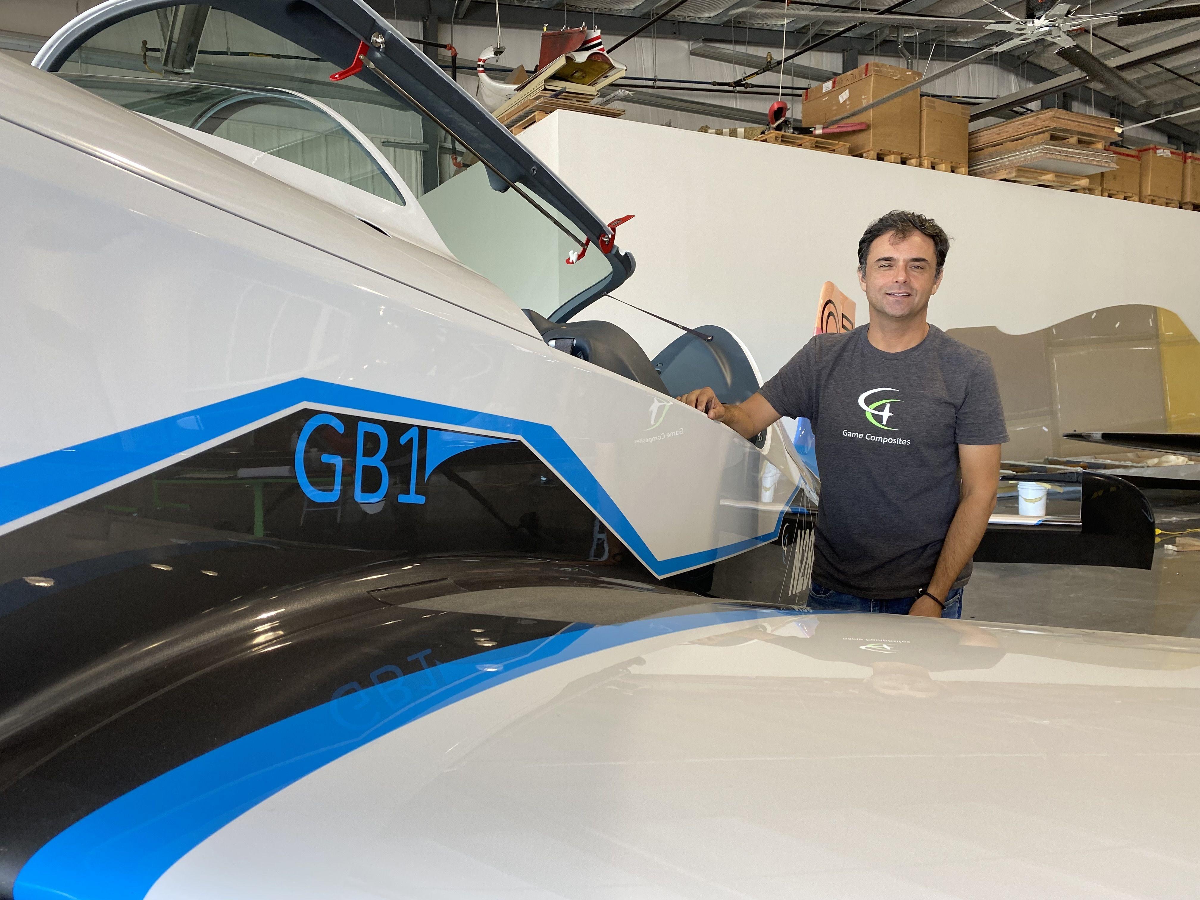 Cristain Bolton, a test pilot, shows of a GameBird 1.