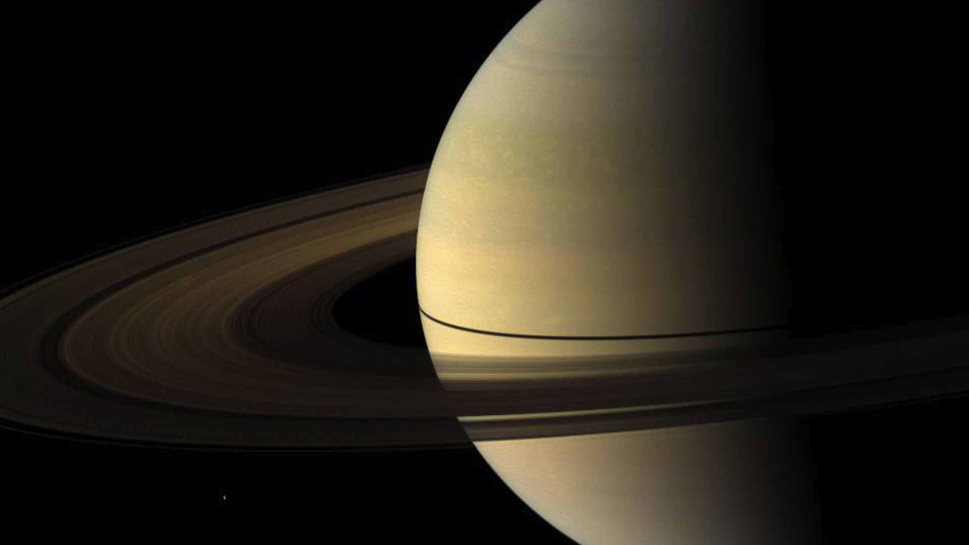 A 2009 image from Cassini of Saturn's rings casting a narrow shadow on the planet.