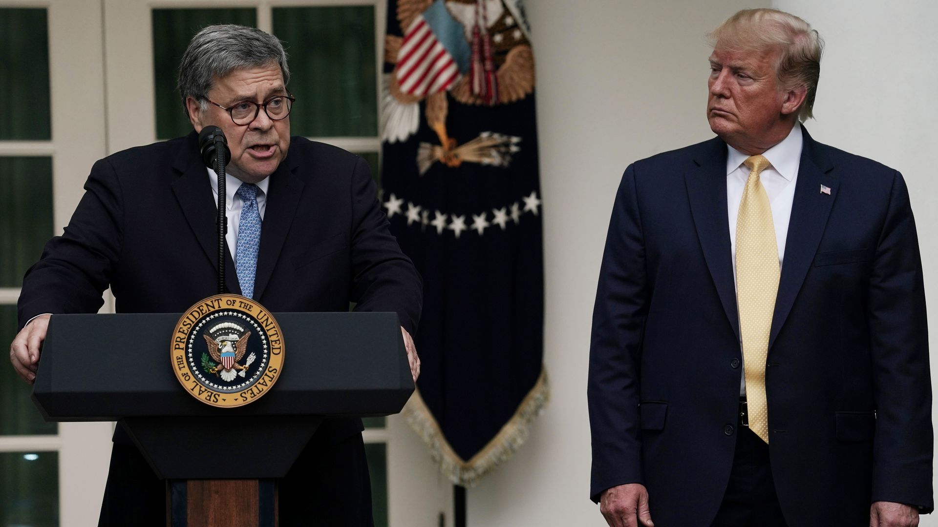 Attorney General William Barr speaks as President Donald Trump looks on during a Rose Garden statement on the census July 11