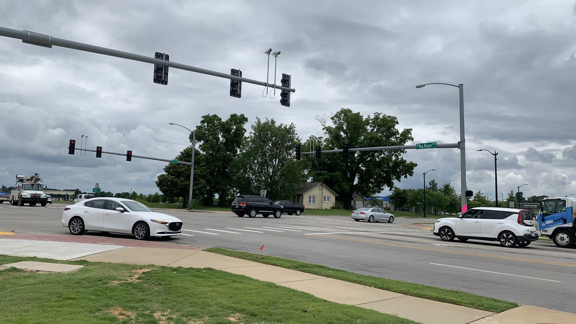 Cars drive through an intersection in Bentonville