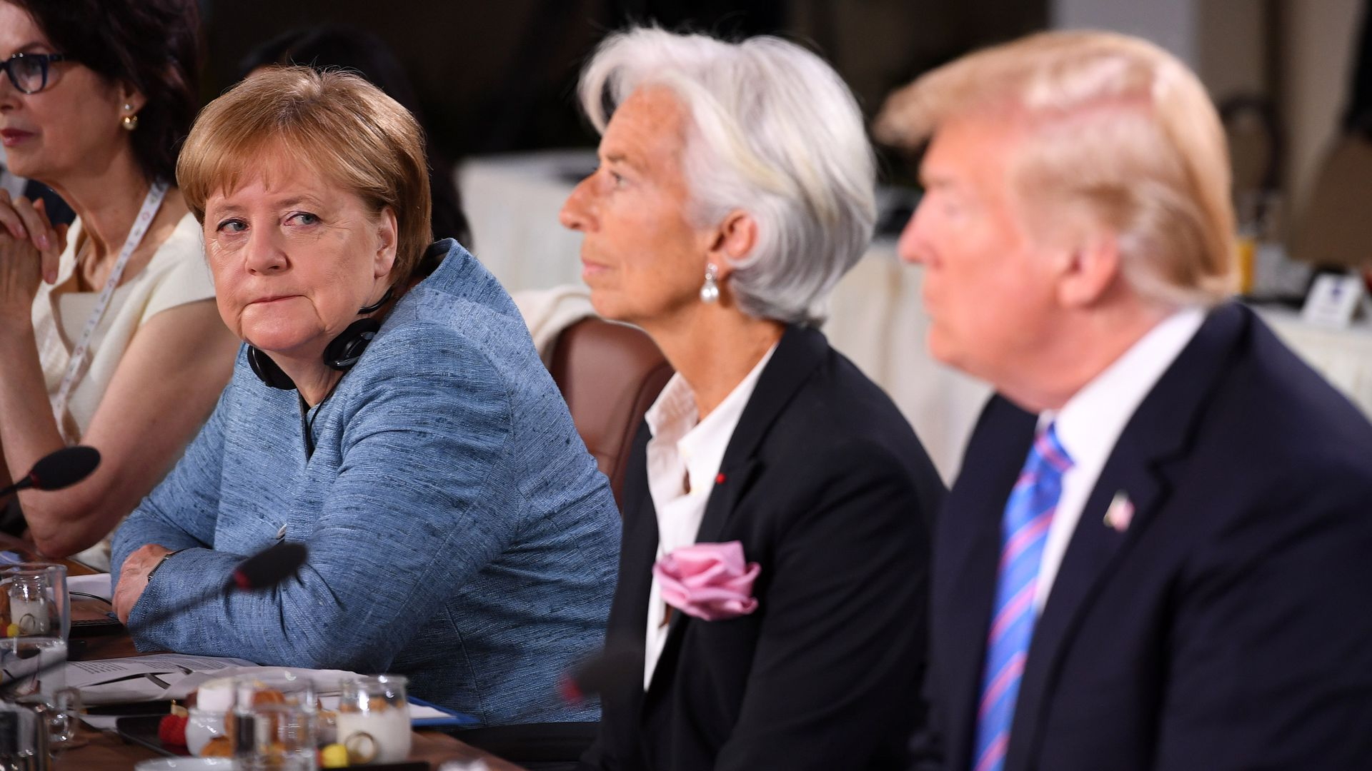 German Chancellor Angela Merkel looks towards President Donald Trump during a working breakfast at the G7 Summit on Friday in Quebec City, Canada.