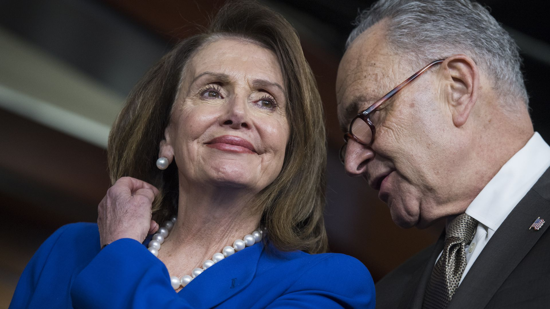 Nancy Pelosi and CHuck Shumer speak to each other