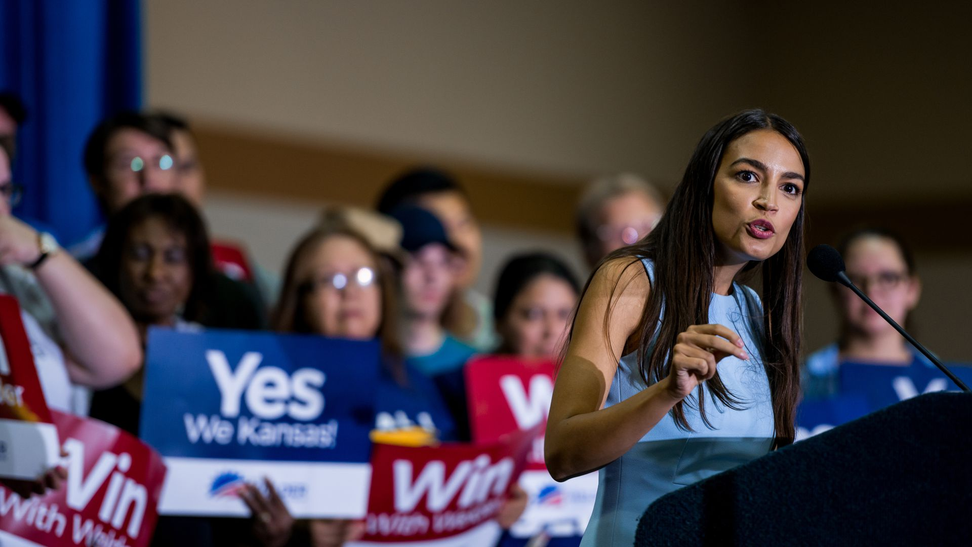 Alexandria Ocasio-Cortez speaking at a rally in Kansas