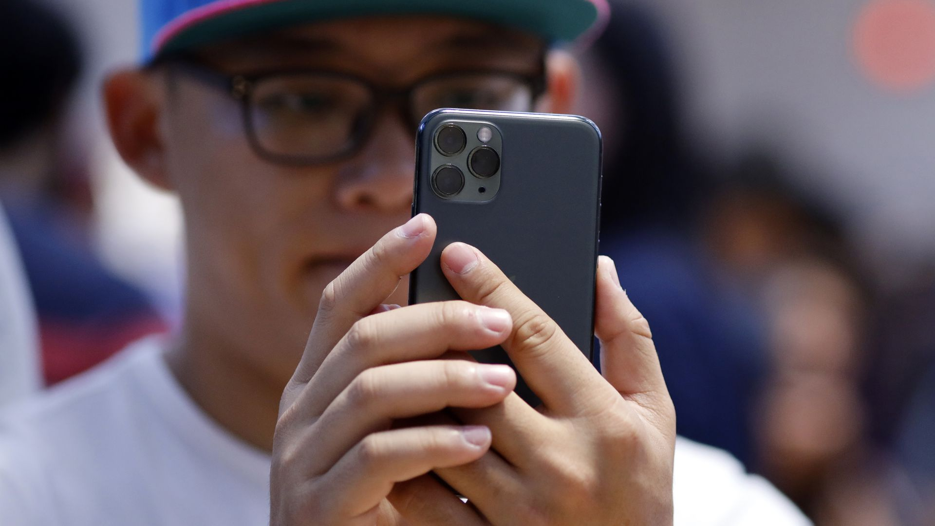 A customer tries an iPhone 11 Pro Max.