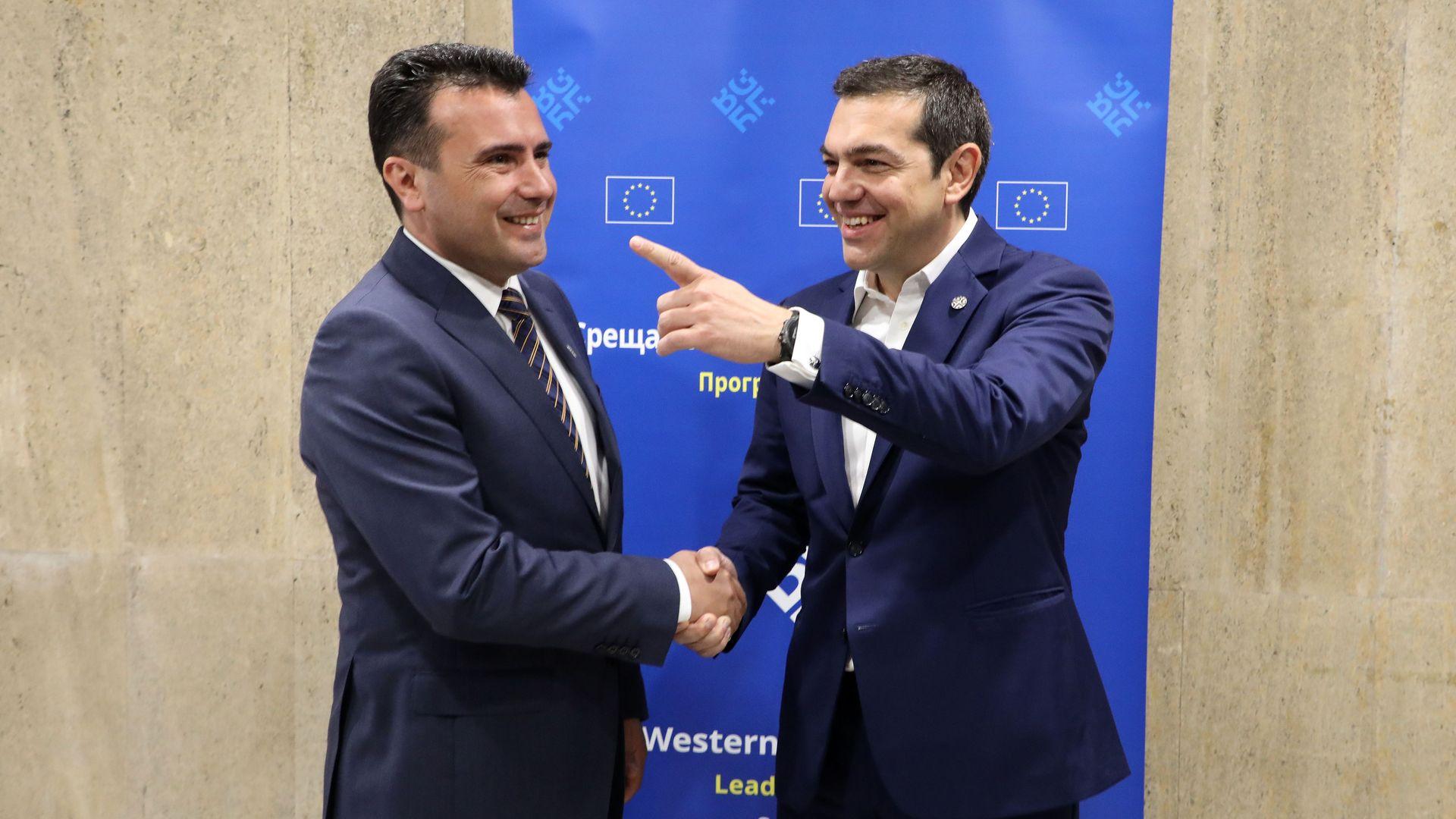 Greece's Prime minister Alexis Tsipras (R) and Macedonia's Prime Minister Zoran Zaev