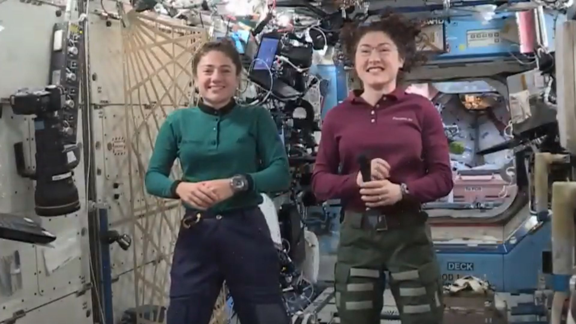 Two astronauts floating on the International Space Station