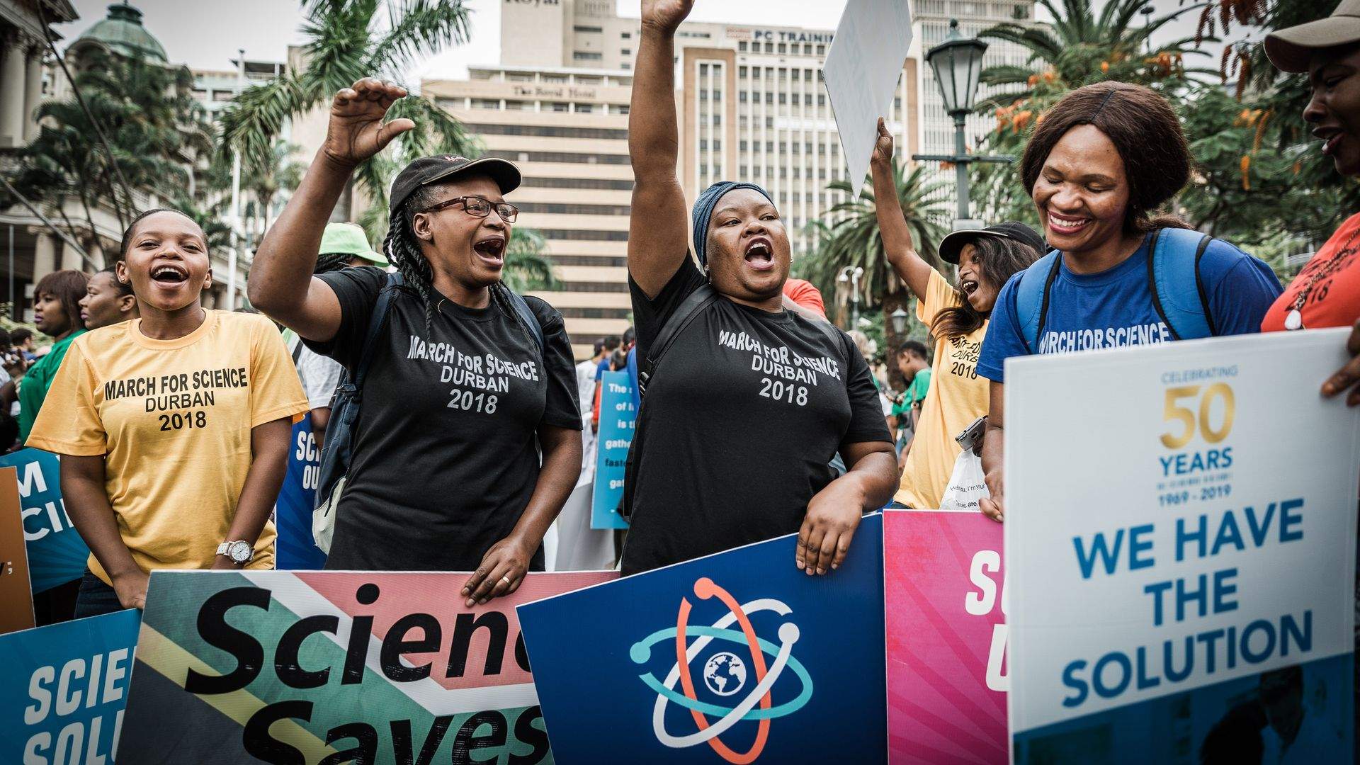 People holding banners shout slogans during the 'March for Science' in Durban