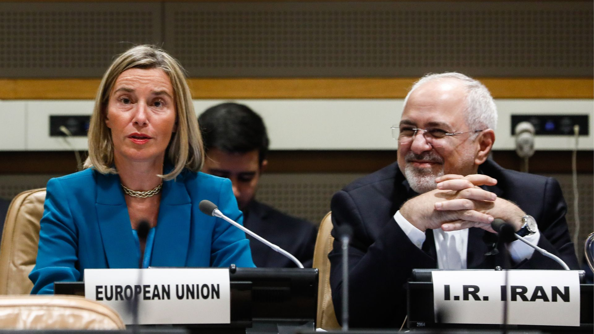EU foreign minister sitting next to Iran foreign minister