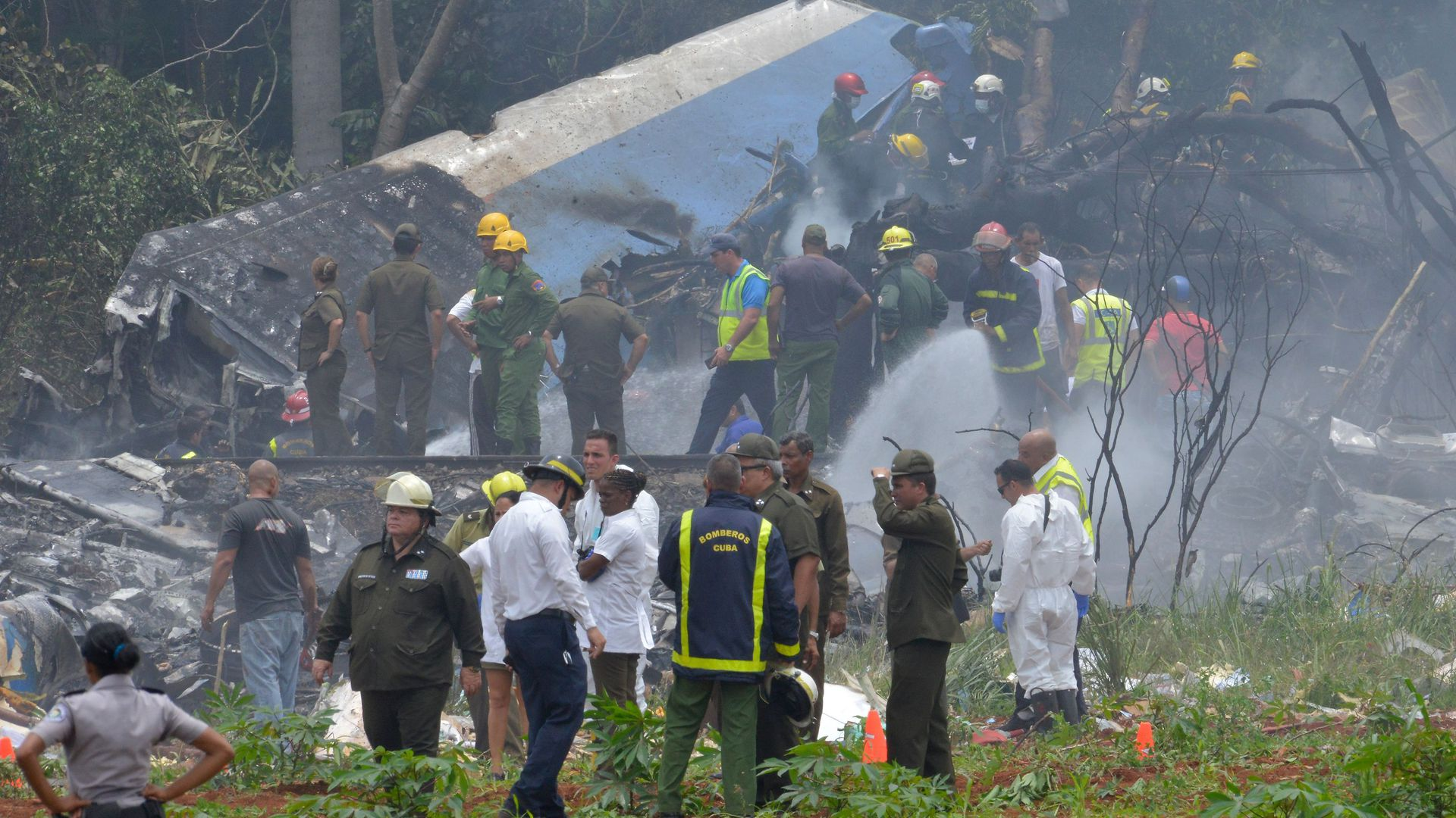 Rescue workers arrive to the scene of the plane crash close to the Havana Airport, in Cuba