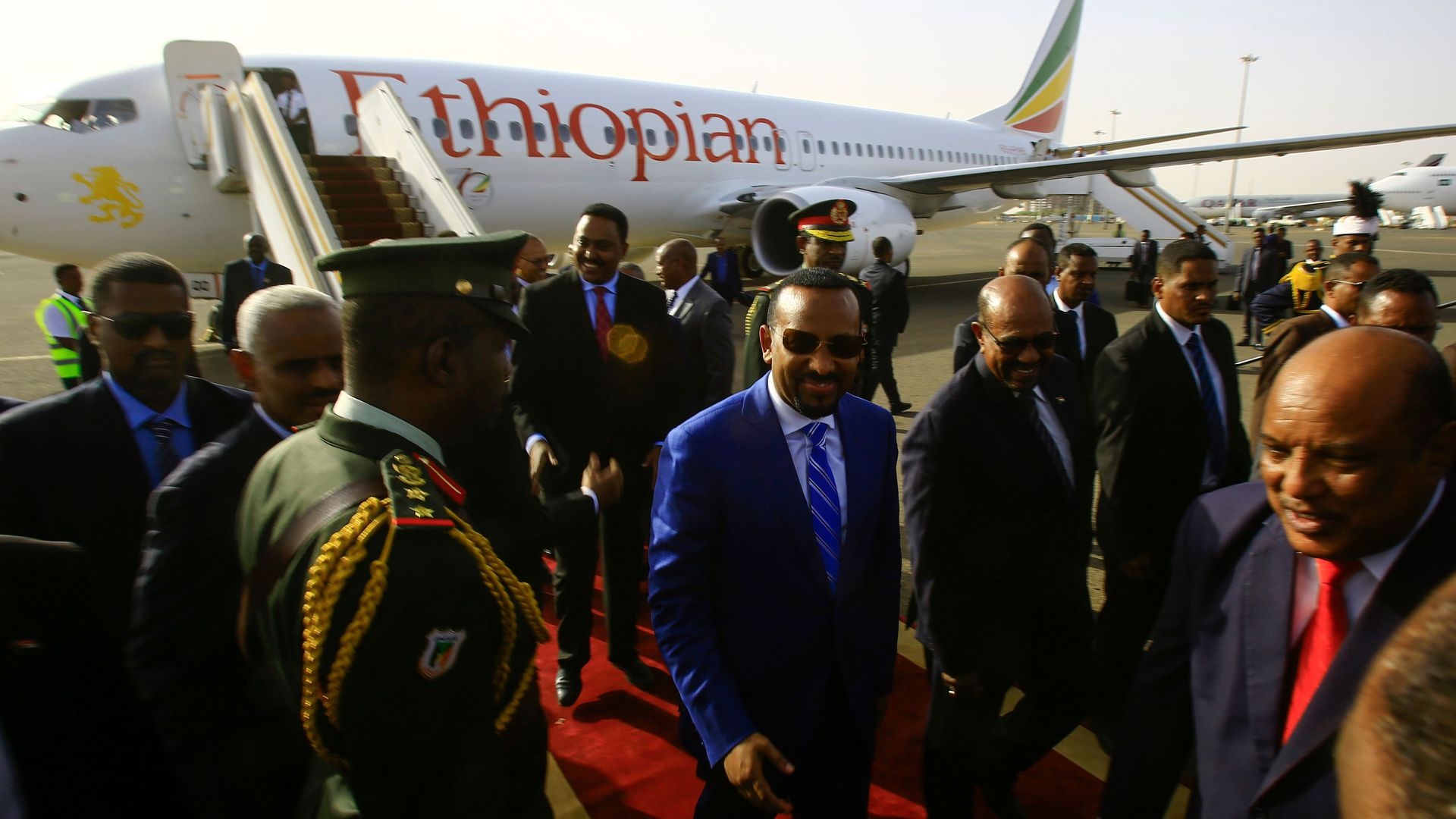 Ethiopian Prime Minister Abiy Ahmed is welcomed by Sudanese President Omar al-Bashir following his arrival in Khartoum for an official visit to Sudan on May 2, 2018.