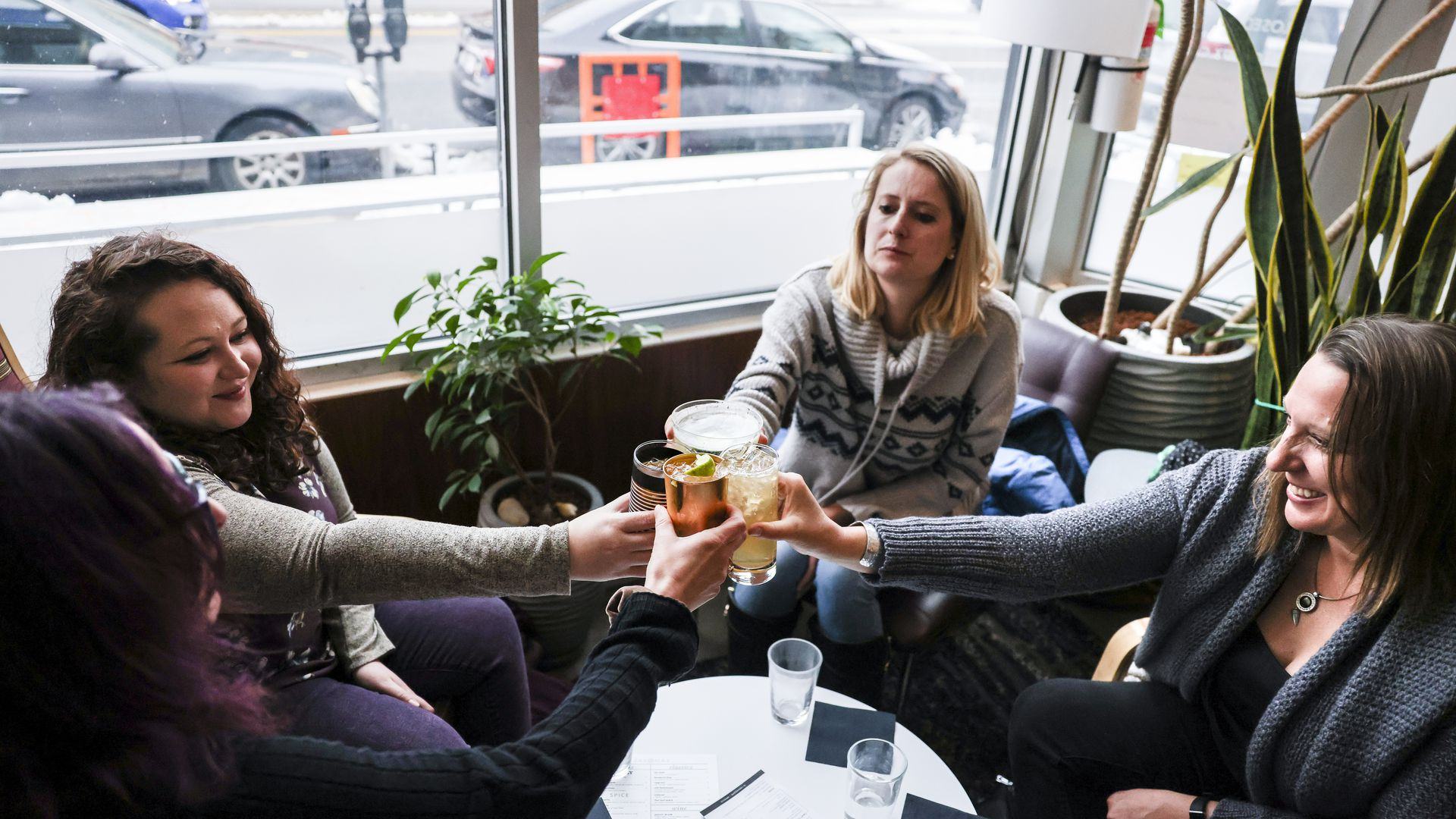 A photo of women toasting with drinks