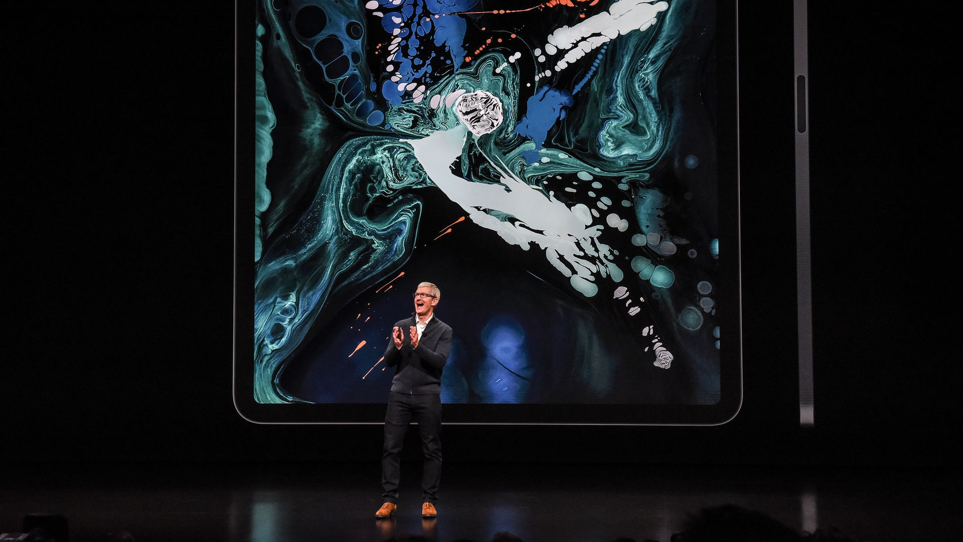 Apple CEO Tim Cook introducing products onstage.