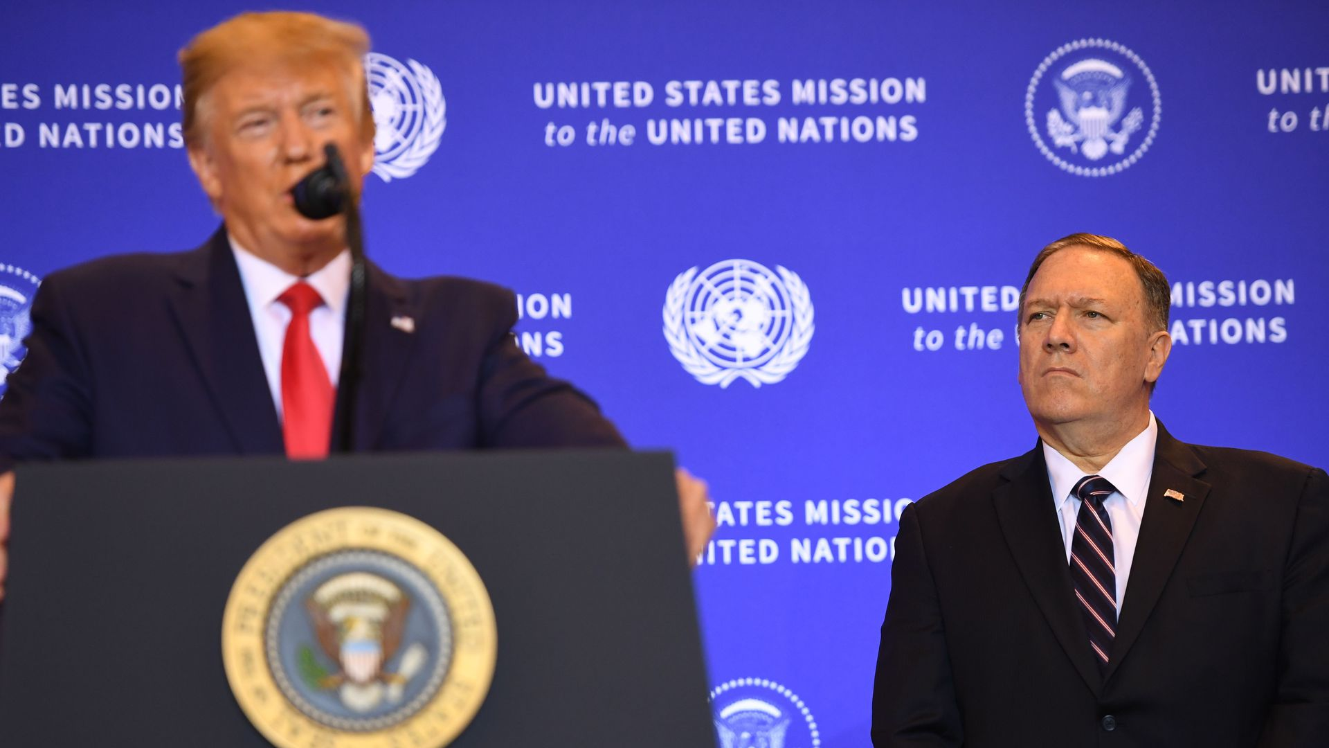 Secretary of State Mike Pompeo (R) listens as President Donald Trump holds a press conference in New York, September 25, 2019, on the sidelines of the United Nations General Assembly.