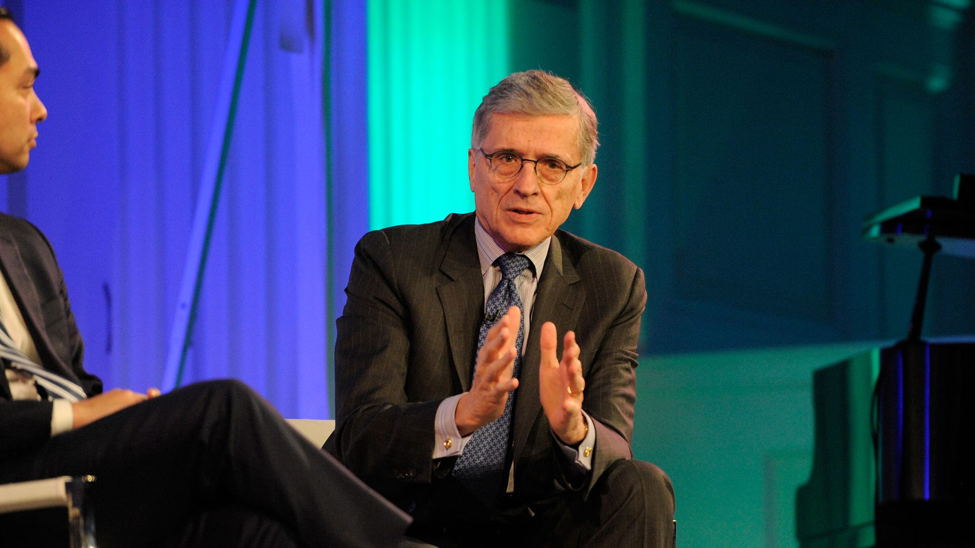 Tom Wheeler on stage in a suit