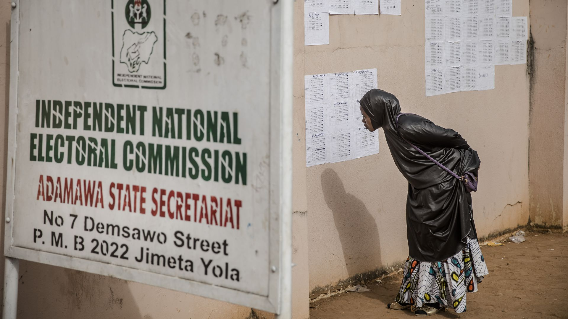 Woman looks at information near Independent Electoral Commission.