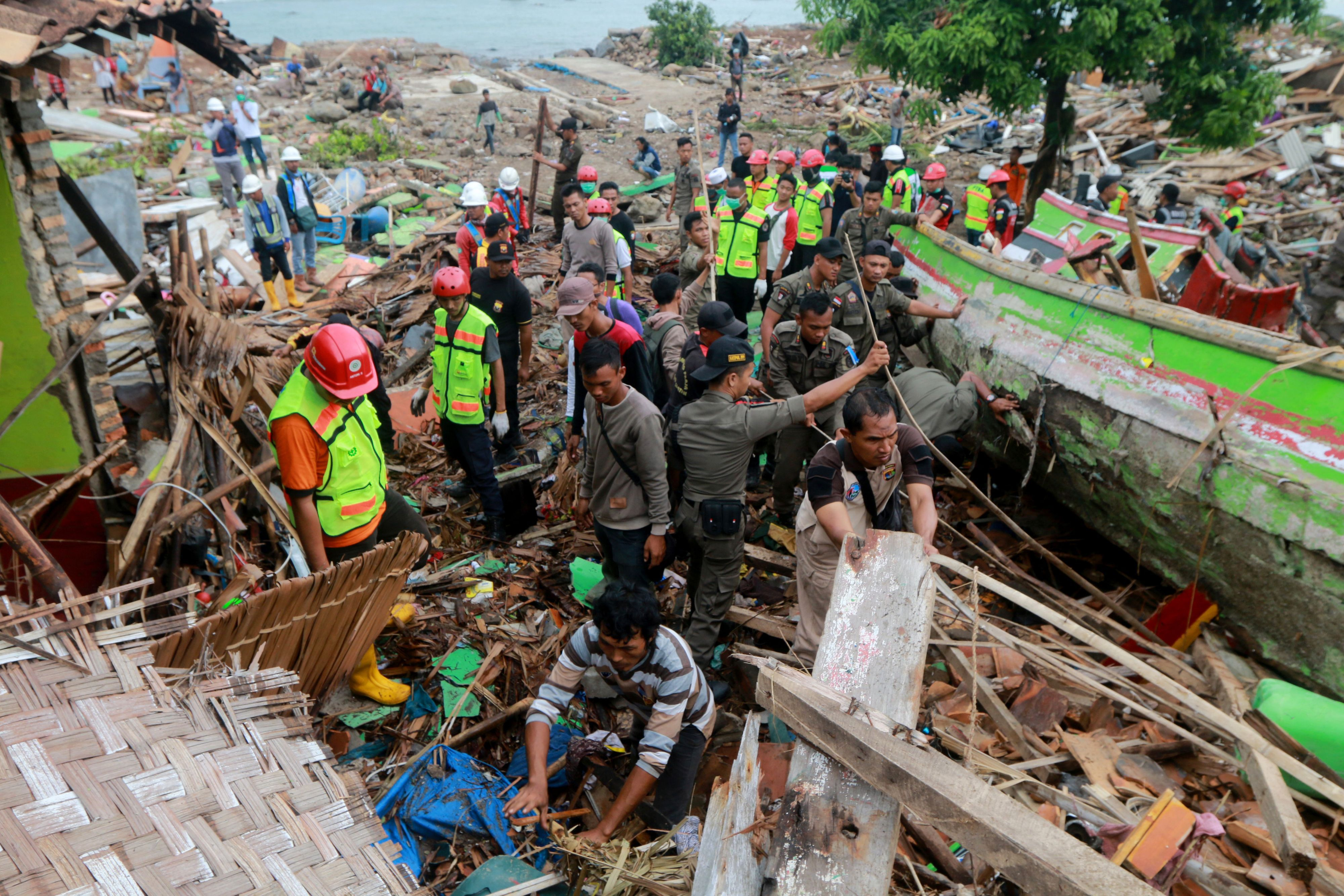 Rescuers look for survivors along the coast of South Sumatra.