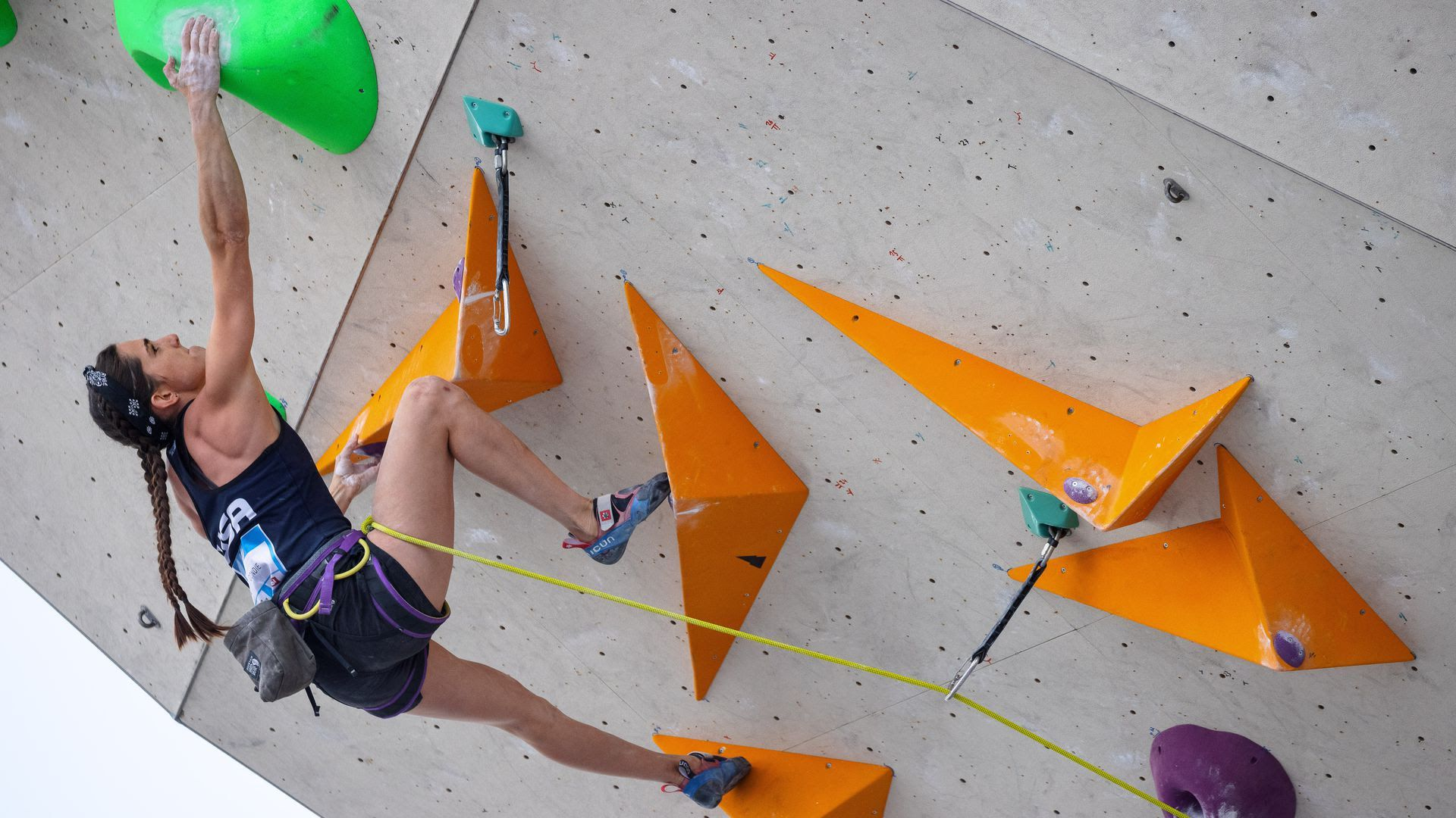 Olympic athlete Kyra Condie climbs an indoor rock climbing wall.