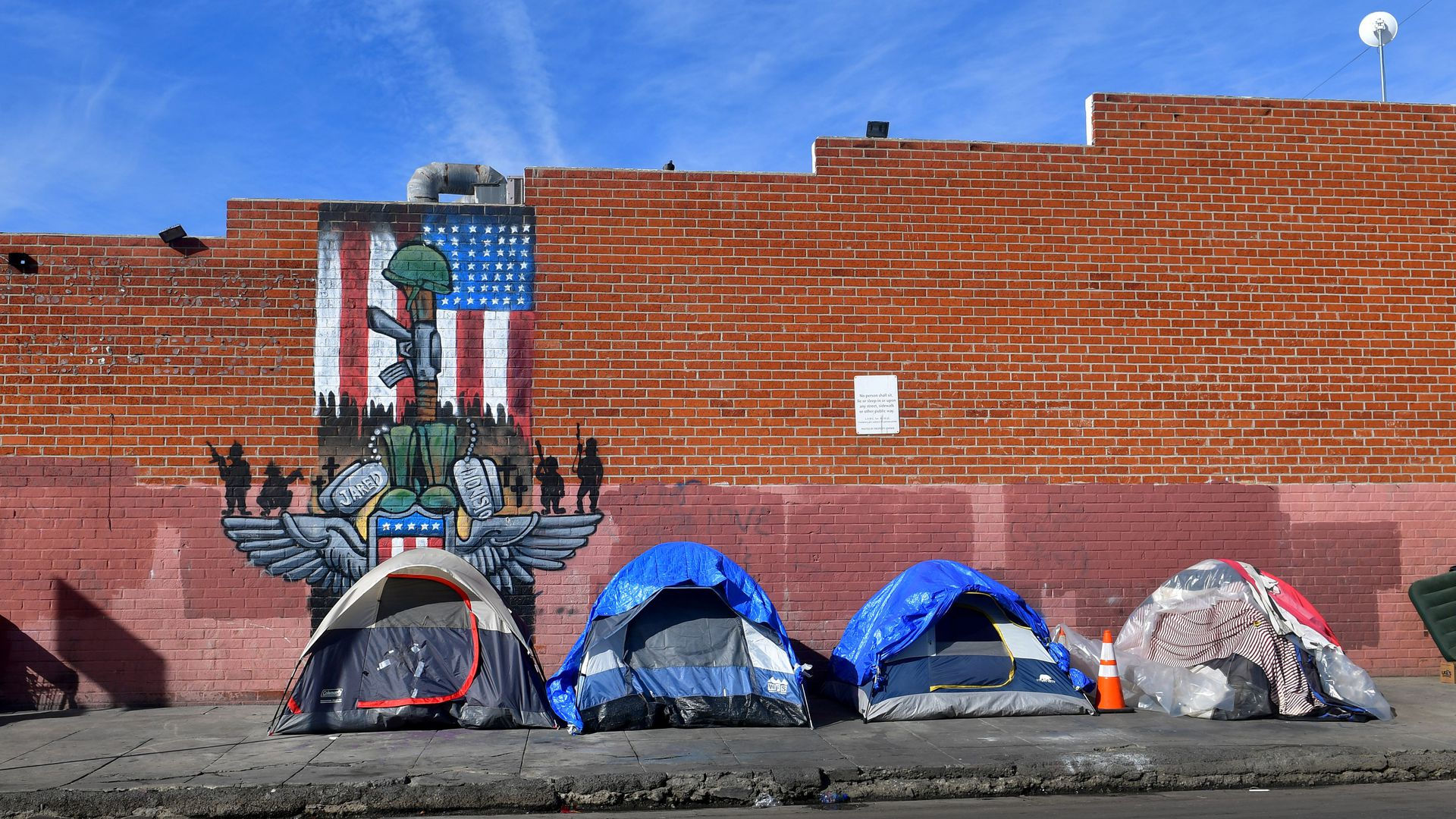 Tents for the homeless line a sidewalk in Los Angeles, California on December 17
