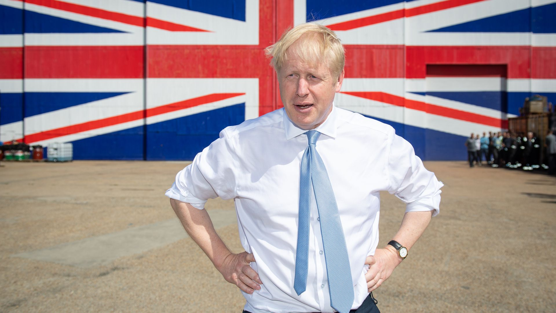 Then-Conservative party leadership contender Boris Johnson  in front of a Union Jack on a wall at the Wight Shipyard Company at Venture Quay during a visit to the Isle of Wight on June 27