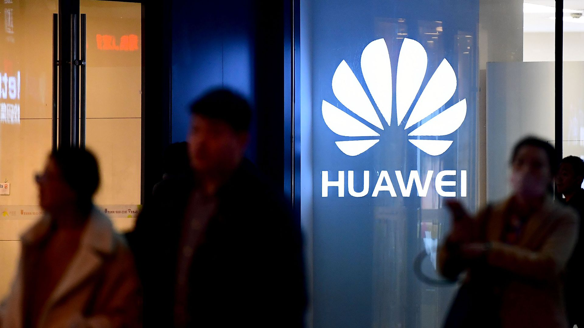 People walk by a Huawei store in Shenyang, Liaoning Province of China.