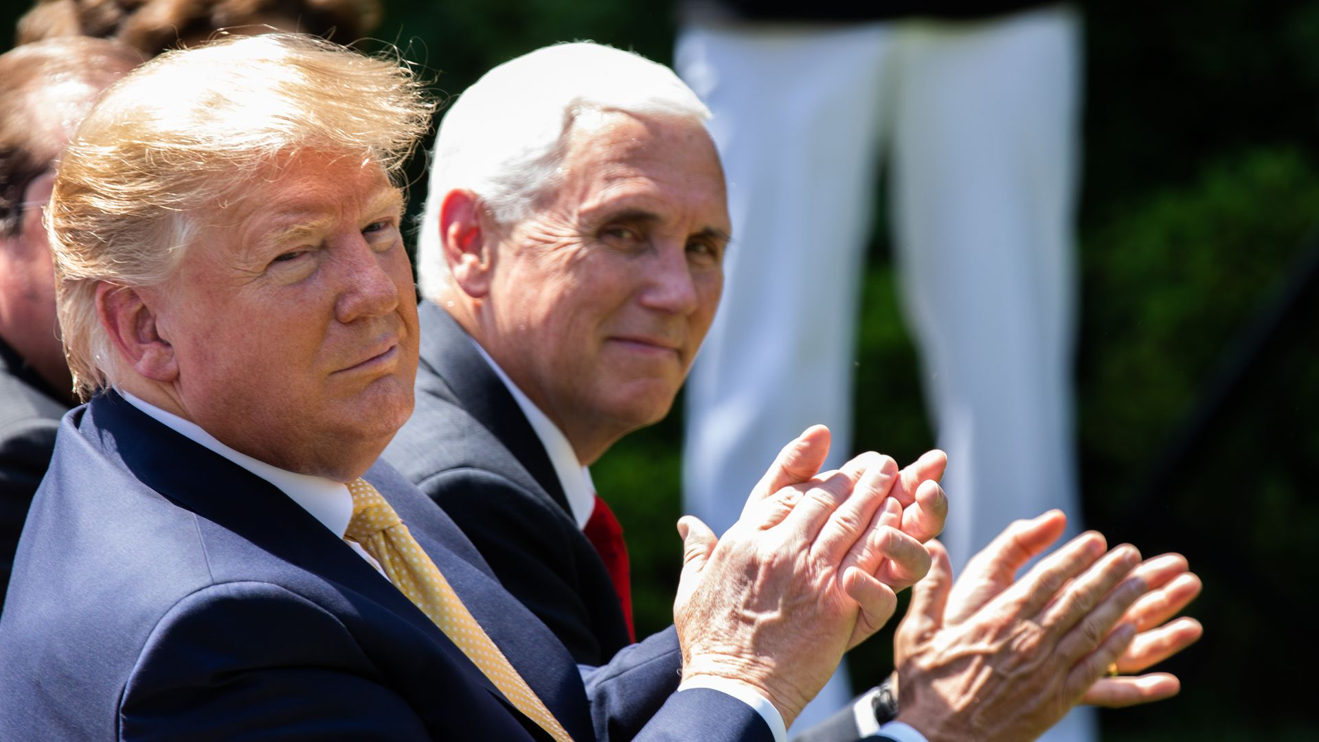 Trump and Pence clapping