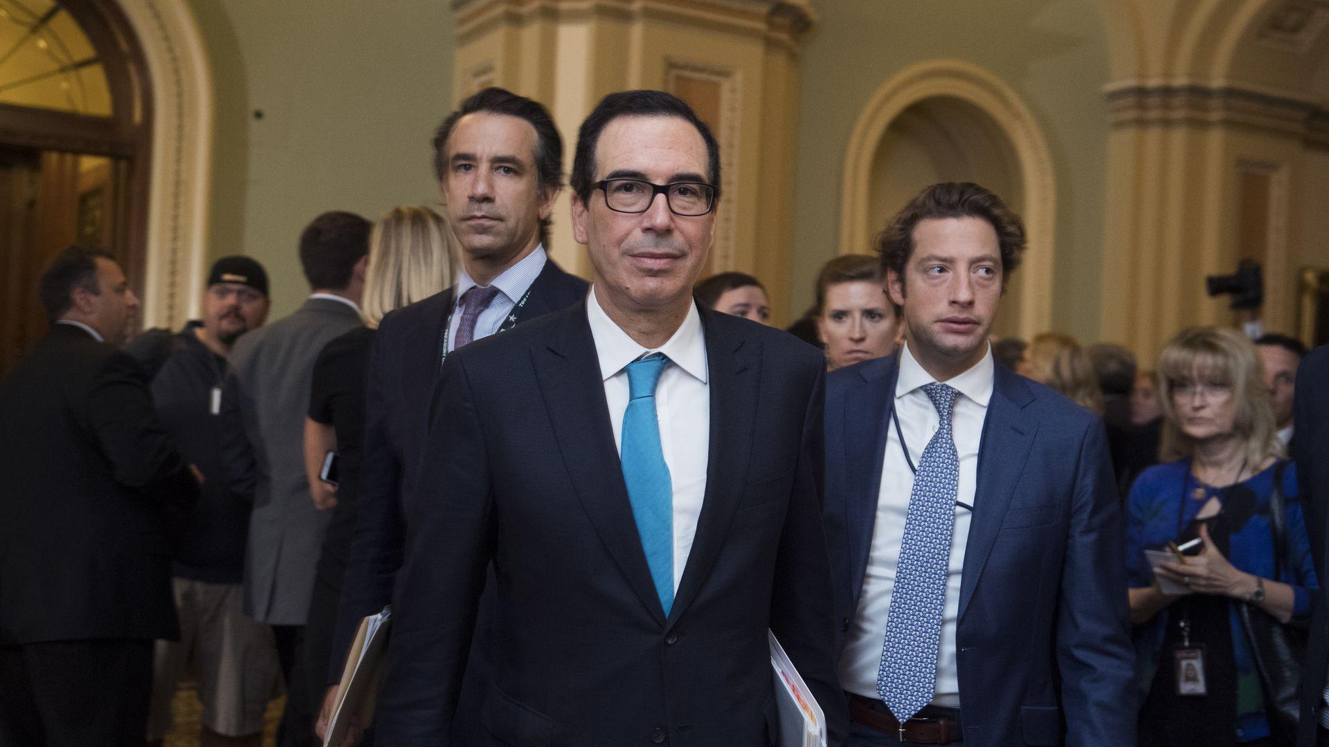 Treasury secretary Steven Mnuchin wearing black suit.