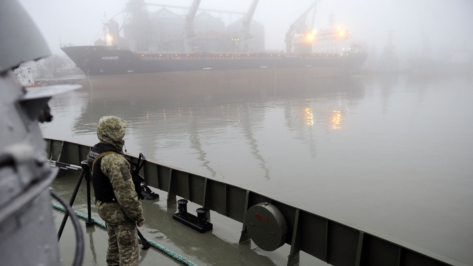 Ukrainian soldier stands guard aboard military boat called 'Dondass' moored in Mariupol, Sea of Azov port on November 27, 2018.