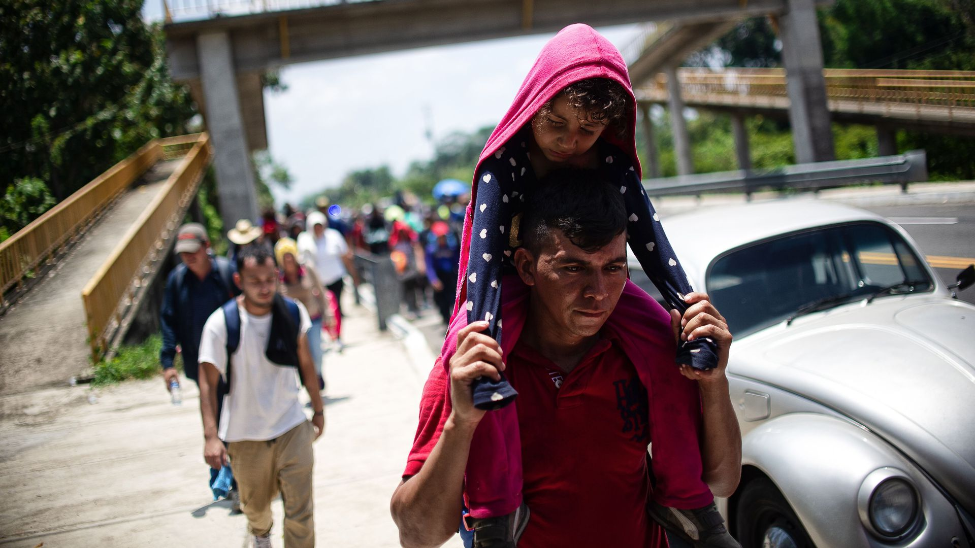 Central American migrants heading in caravan to the US rest beside the road between Metapa and Tapachula in Mexico on April 12.