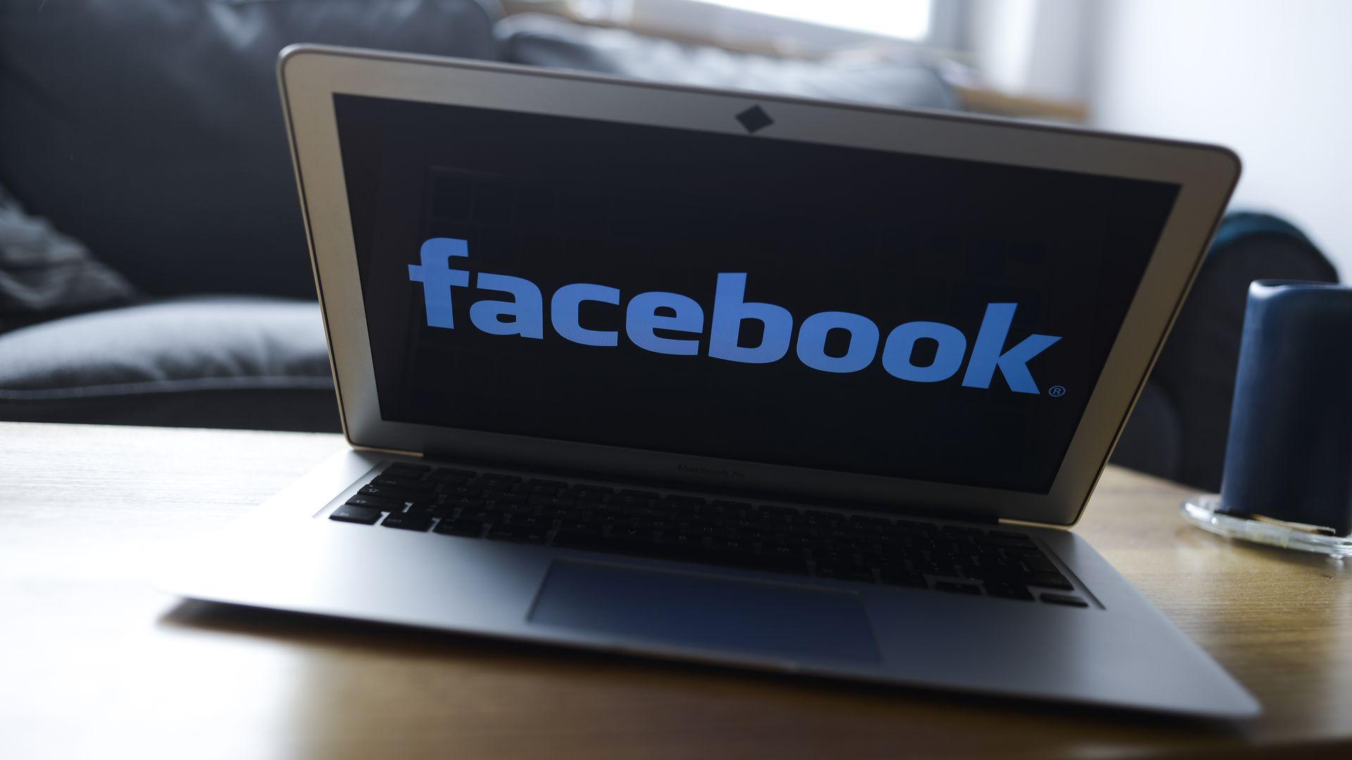 Facebook logo on a laptop
