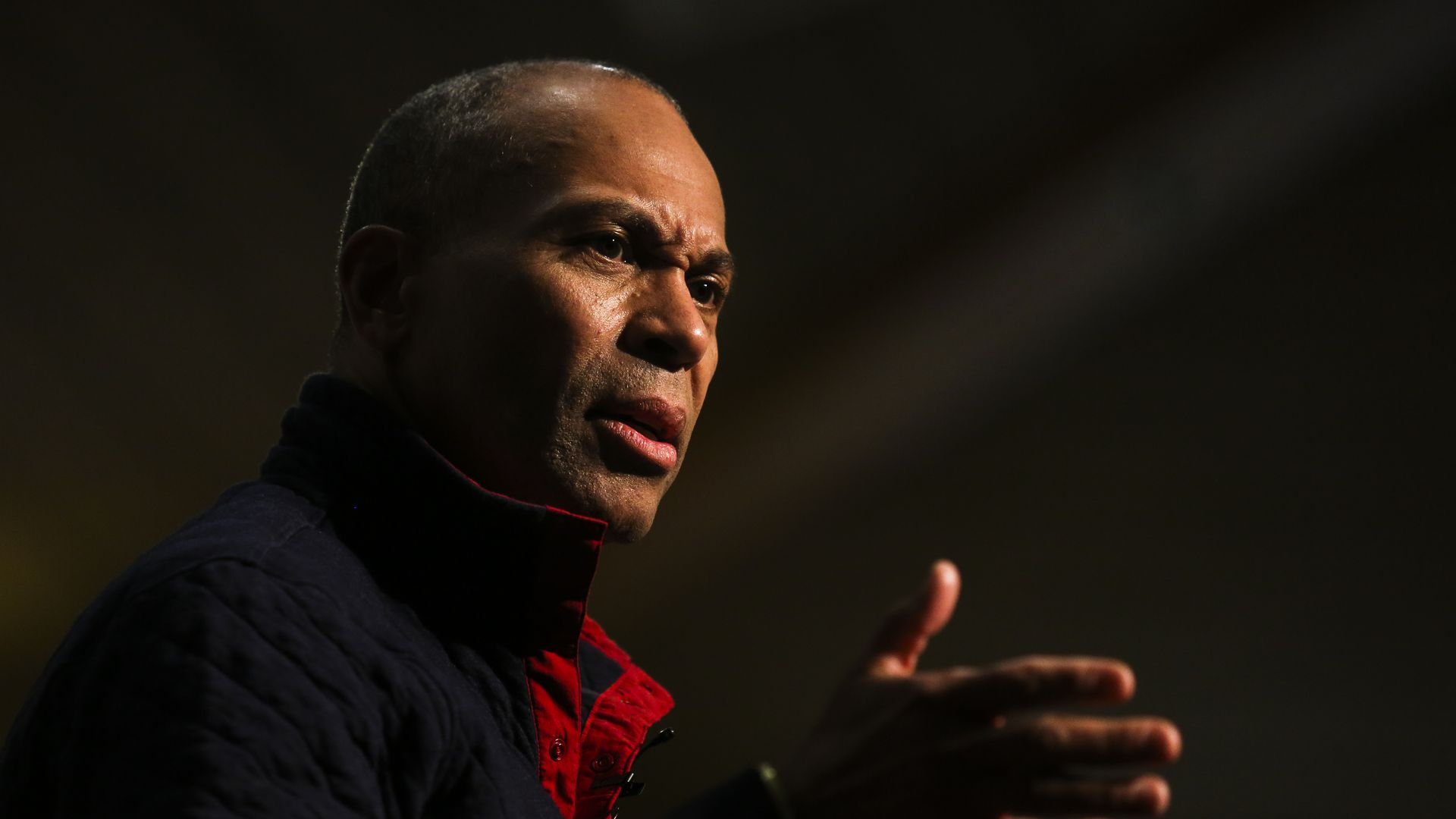 Close-up shot of former Massachusetts Governor Deval Patrick at a presidential campaign event
