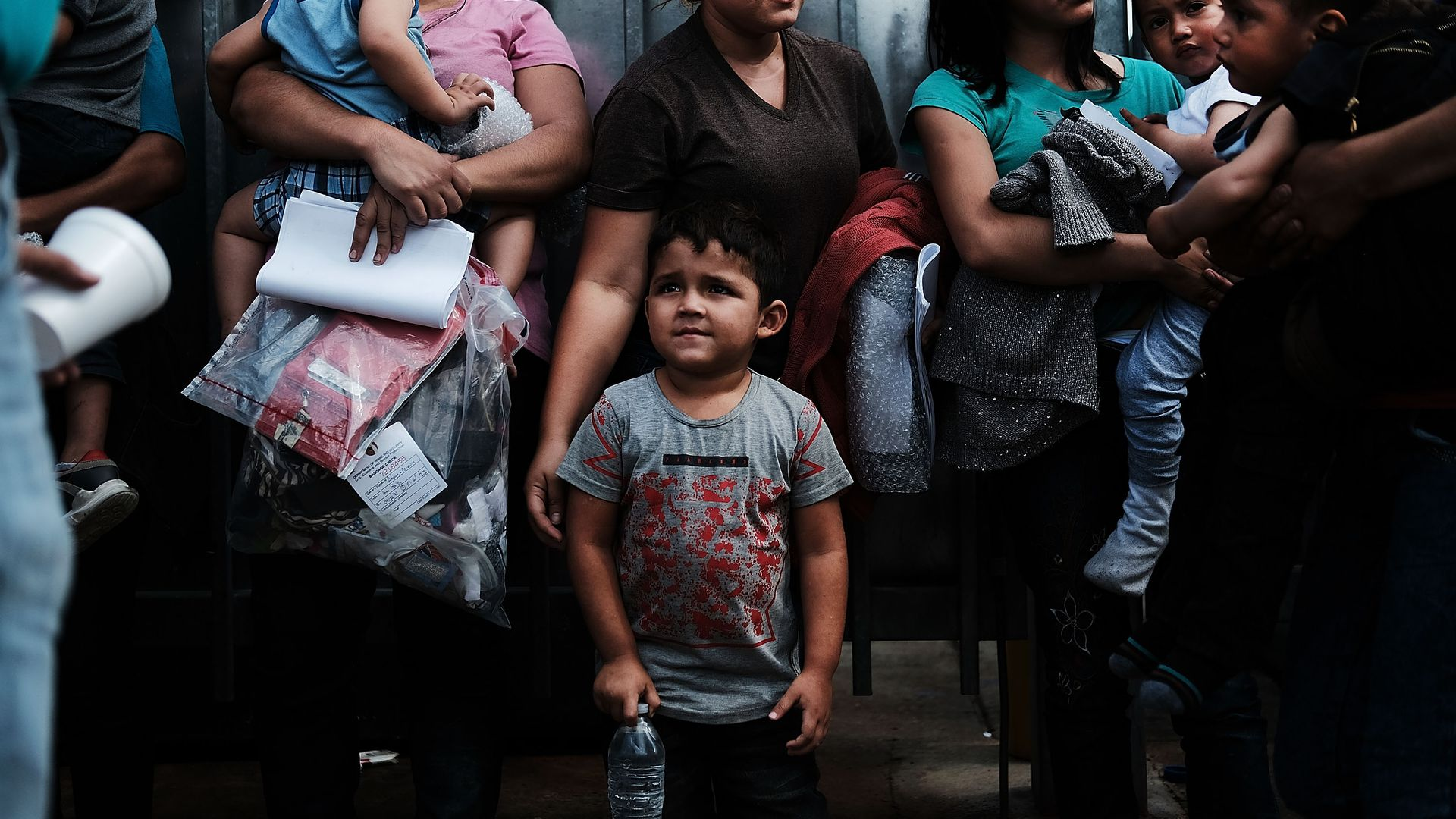 Dozens of women and their children, many fleeing poverty and violence in Honduras, Guatamala and El Salvador, arrive at a bus station following release from Customs and Border Protection in Texas.