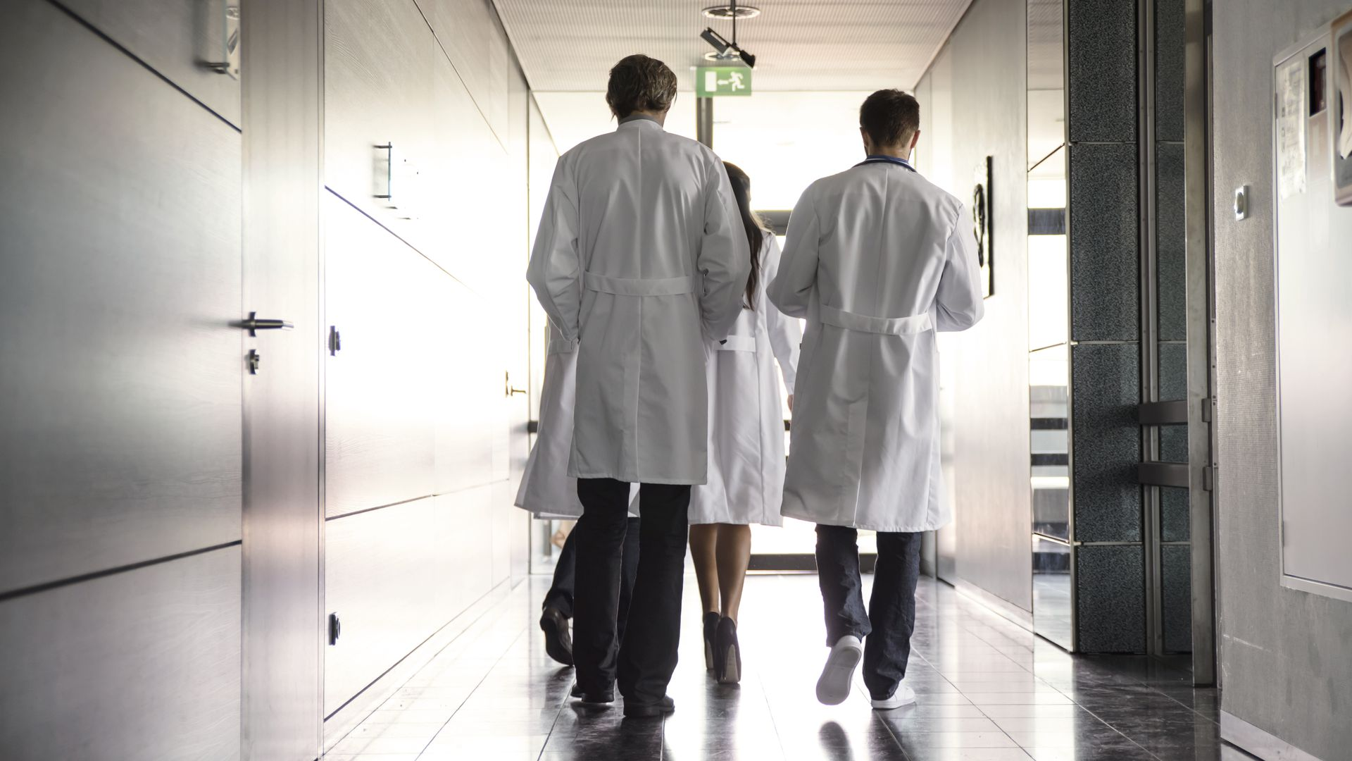 Team of doctors walking down a hall