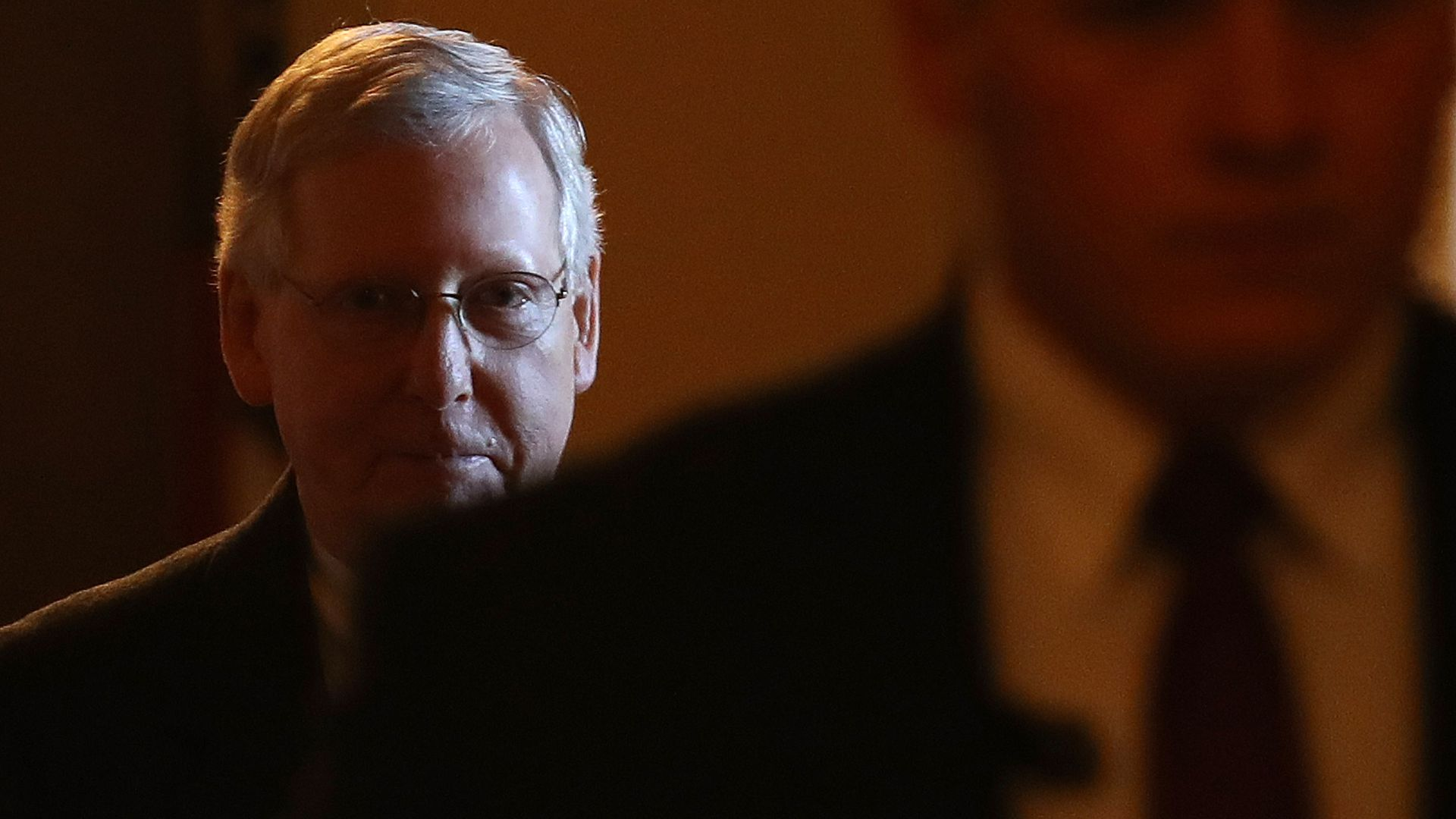 A mysterious and silhouetted Mitch McConnell