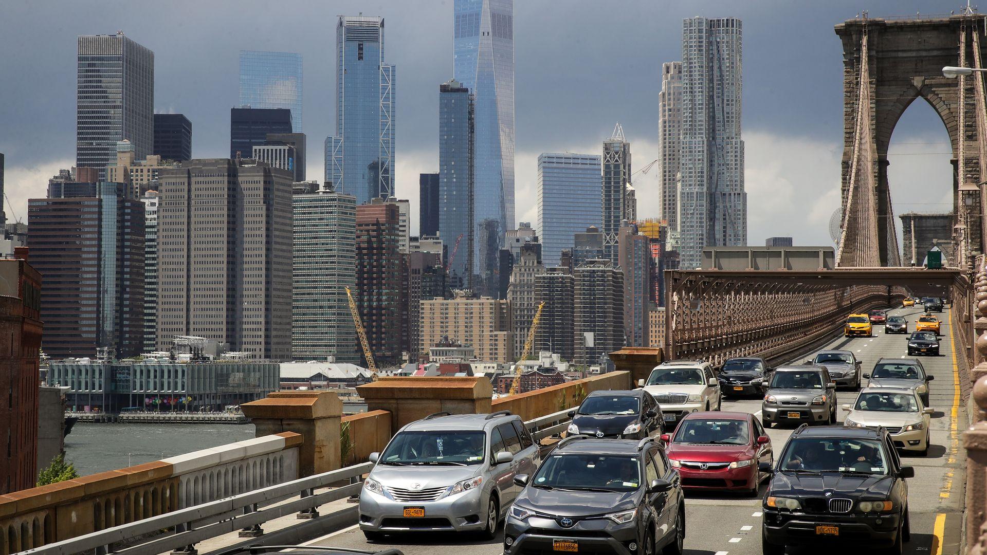 view of lower Manhattan and traffic on Brooklyn Bridge