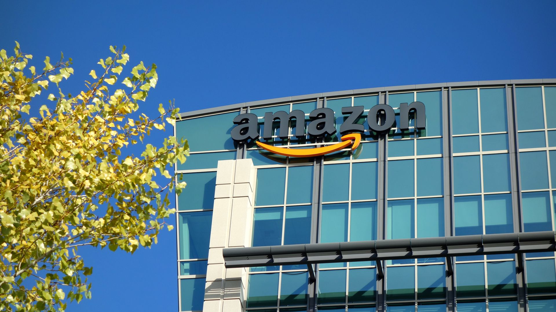 Amazon office building with logo on front.