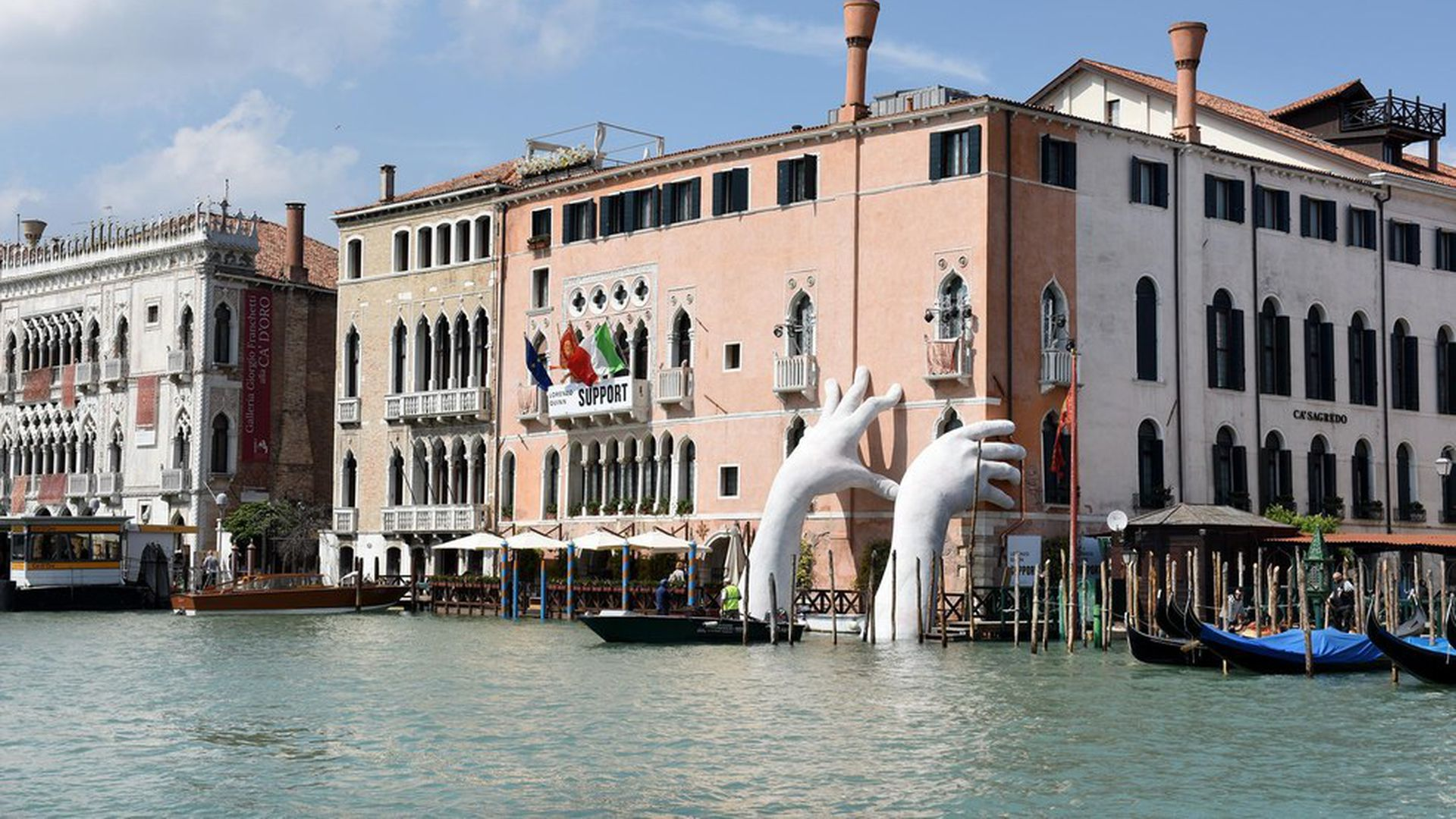 How giant hands in Venice combat climate change