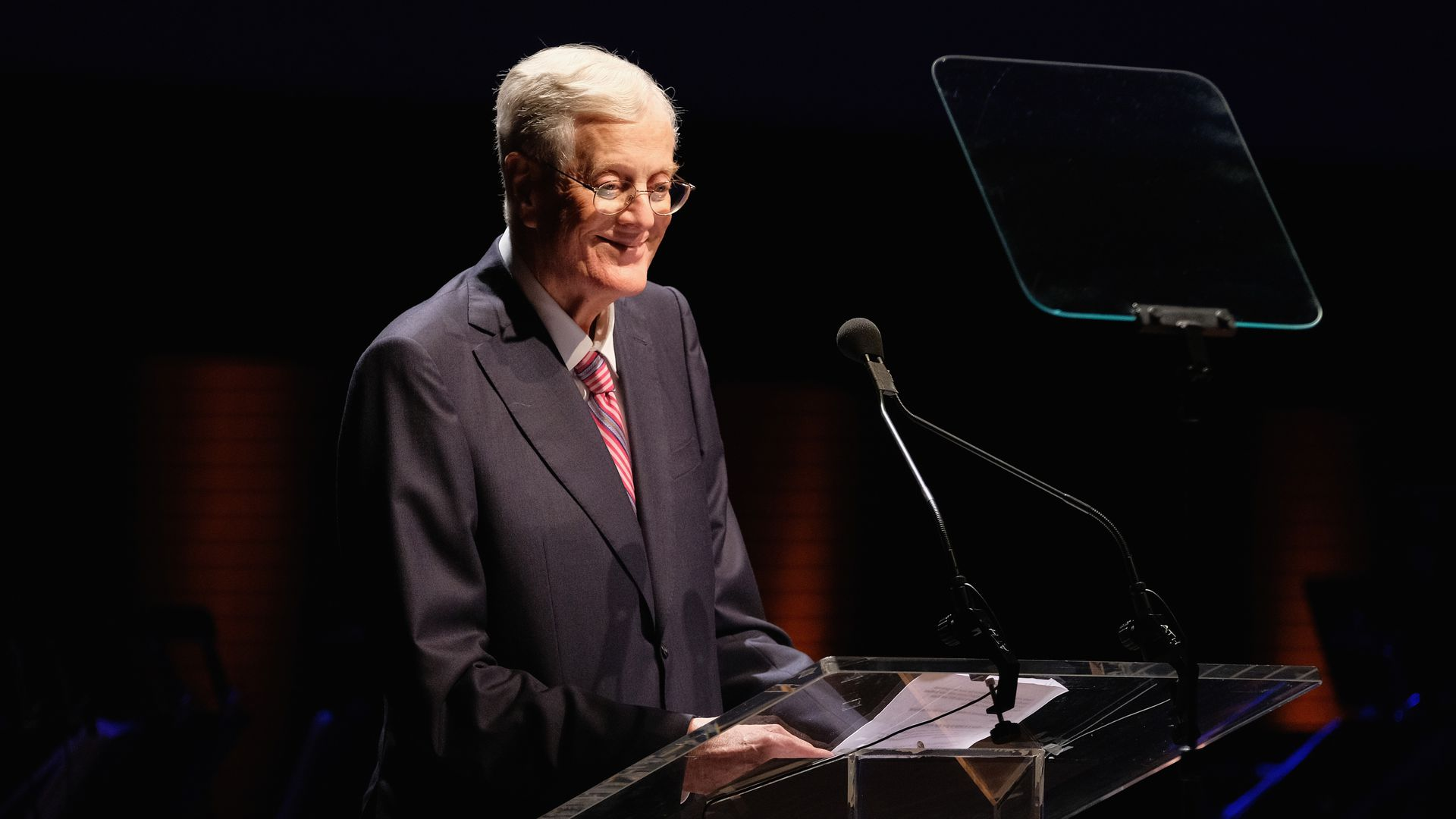 David H. Koch smiles at a podium as he accepts the Laureate Award at the Lincoln Center Spring Gala