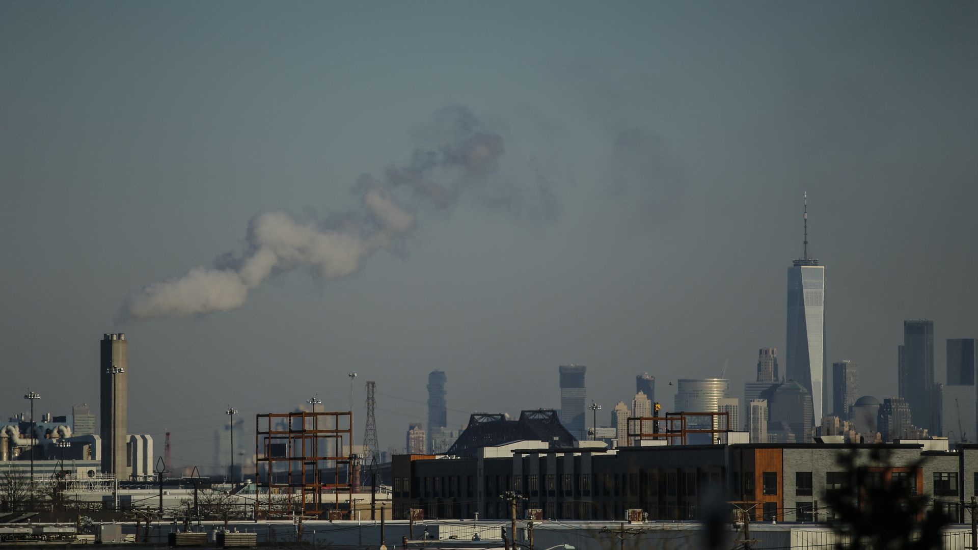 The One World Trade center is seen as a factory emits smoke on January 18, 2018 from Newark, New Jersey.