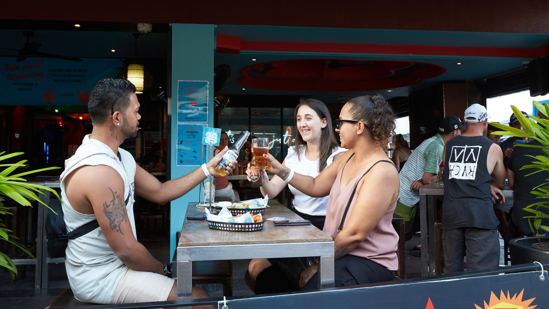 People eat and drink as they sit at Monsoons Bar on Mitchell st on May 15, 2020 in Darwin, Australia.