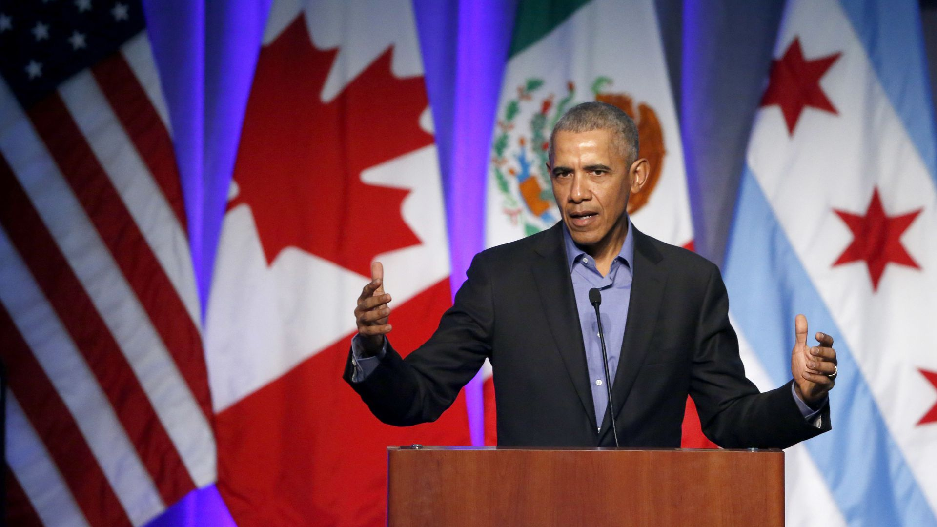 Former U.S. President Barack Obama address the participants at a summit on climate change.