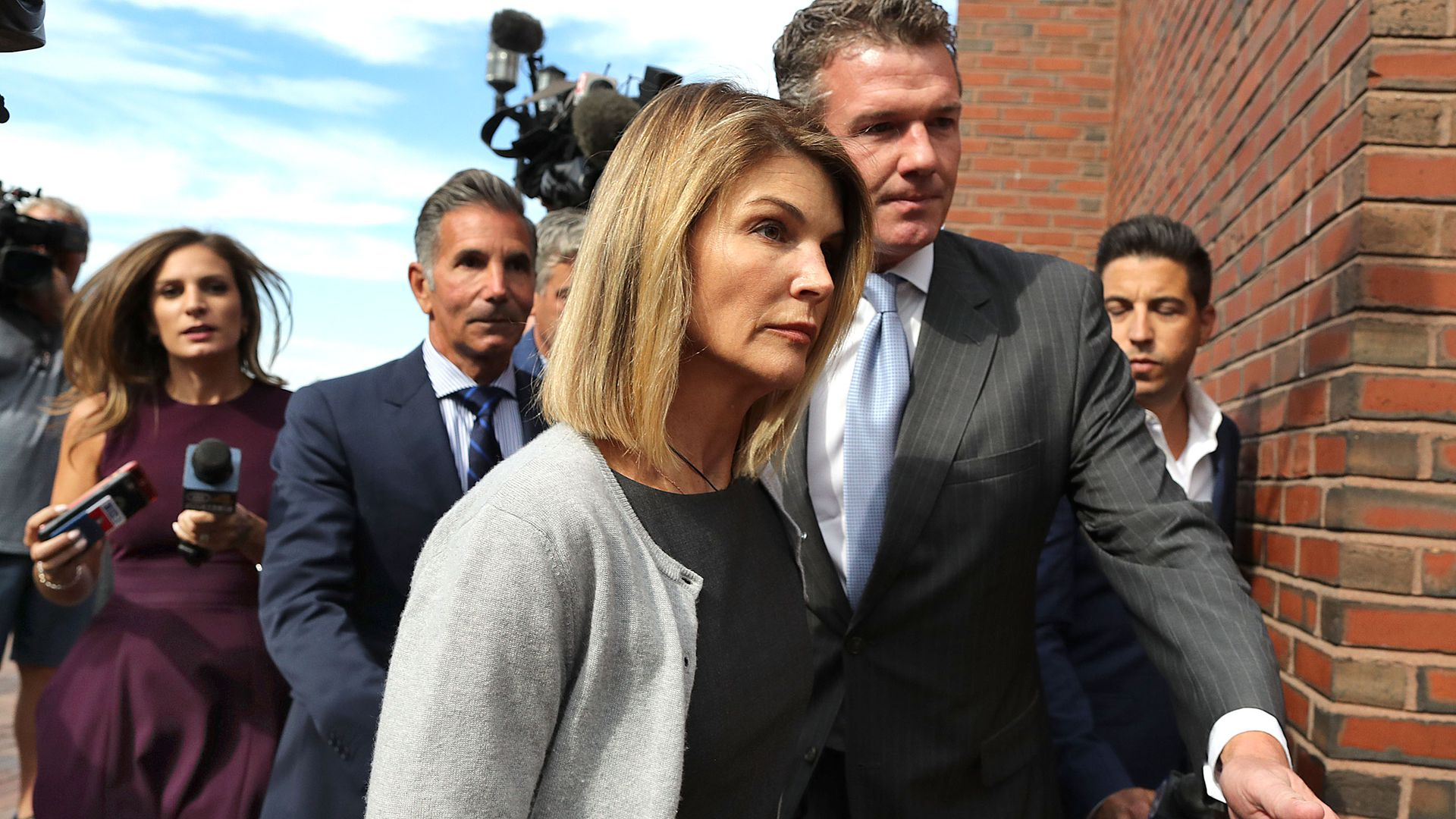 Lori Loughlin and husband sentenced in college bribery scandal - Axios