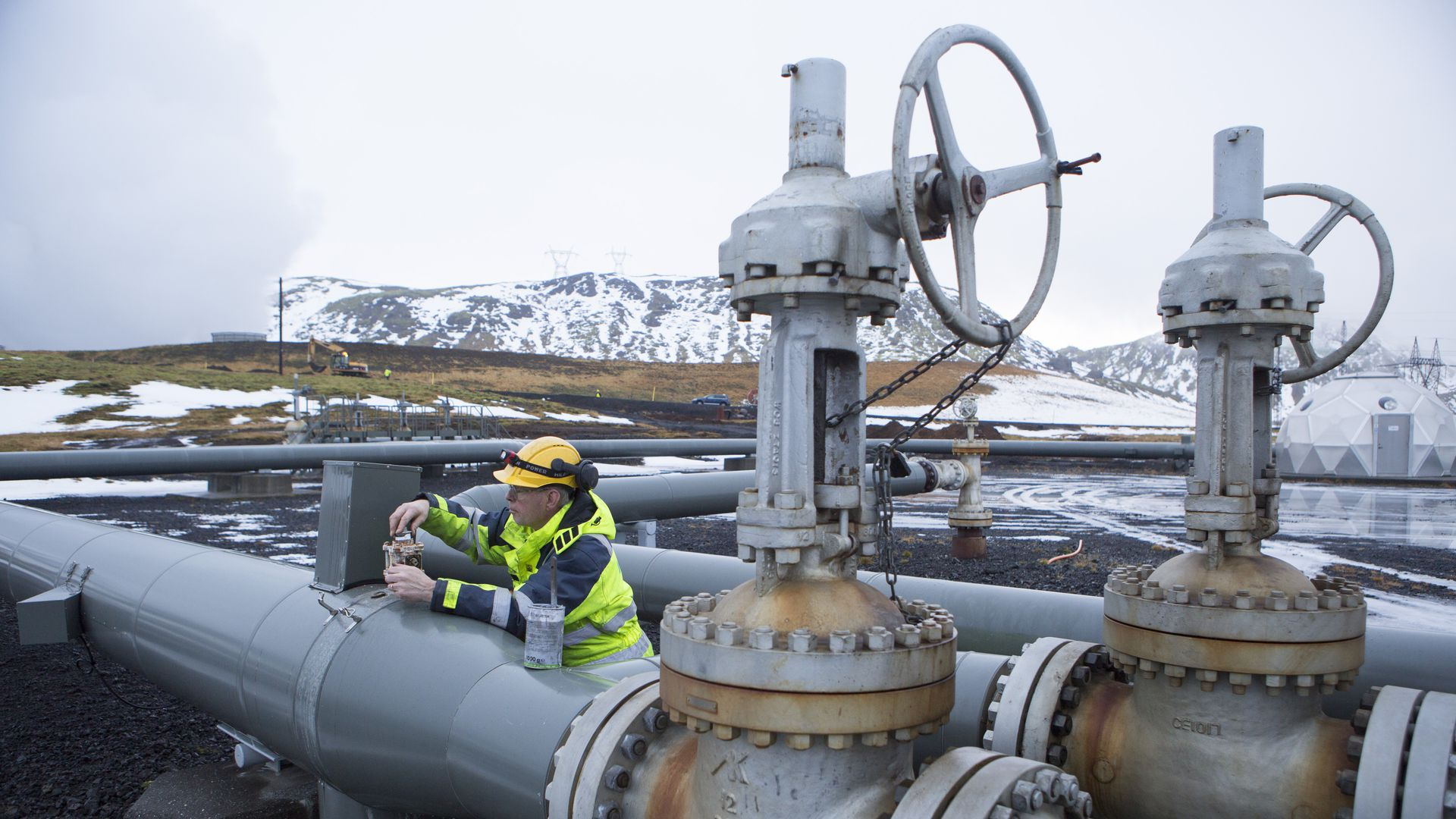 A man works on a pipe beside a carbon injection site well near Reykjavik Energy's Hellisheidi Geothermal Power Plant  outside Reykjavik, Iceland.